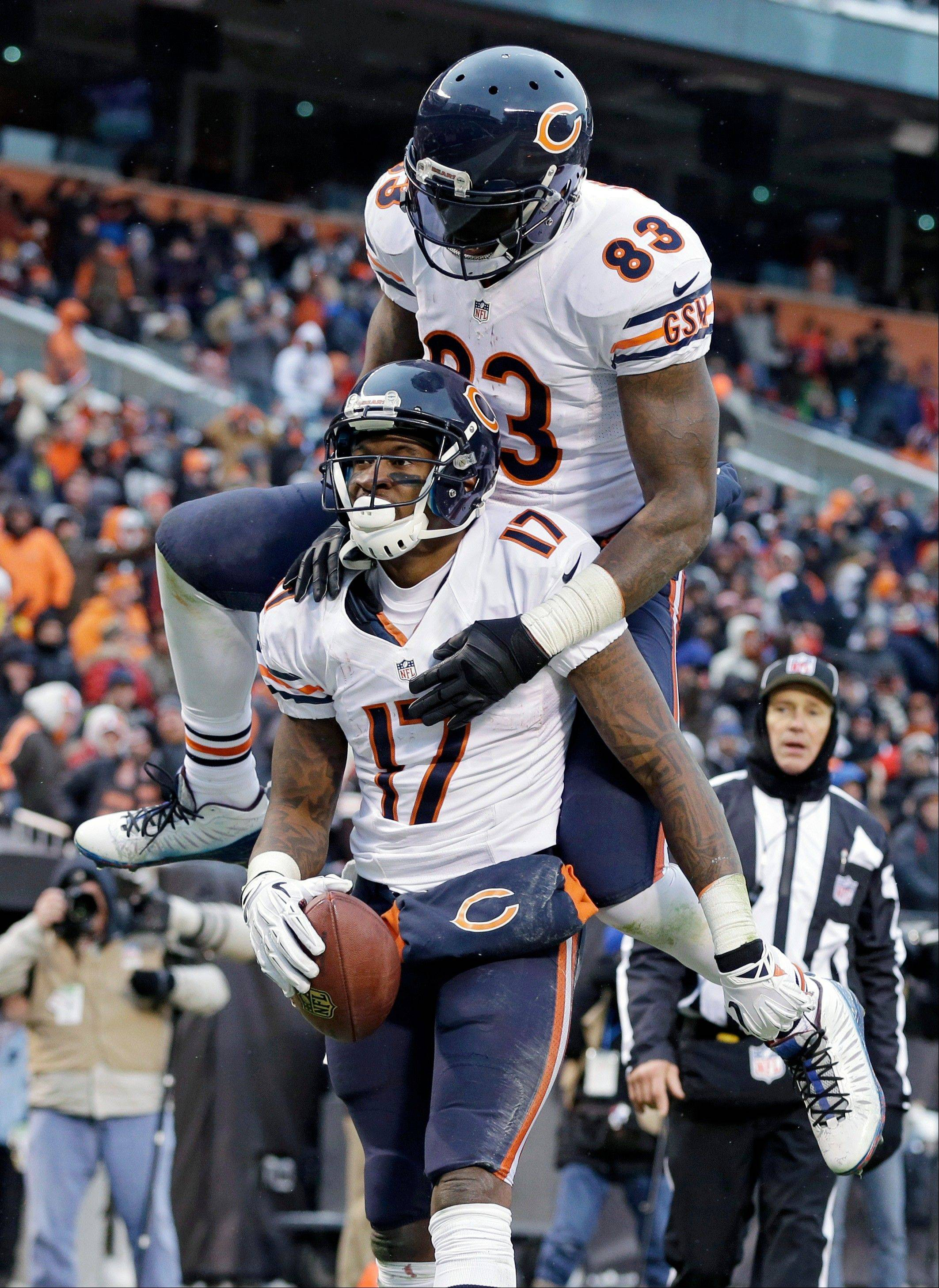 Chicago Bears tight end Martellus Bennett (83) jumps on wide receiver Alshon Jeffery (17) after Jeffrey's 45-yard touchdown catch against the Cleveland Browns in the second half.