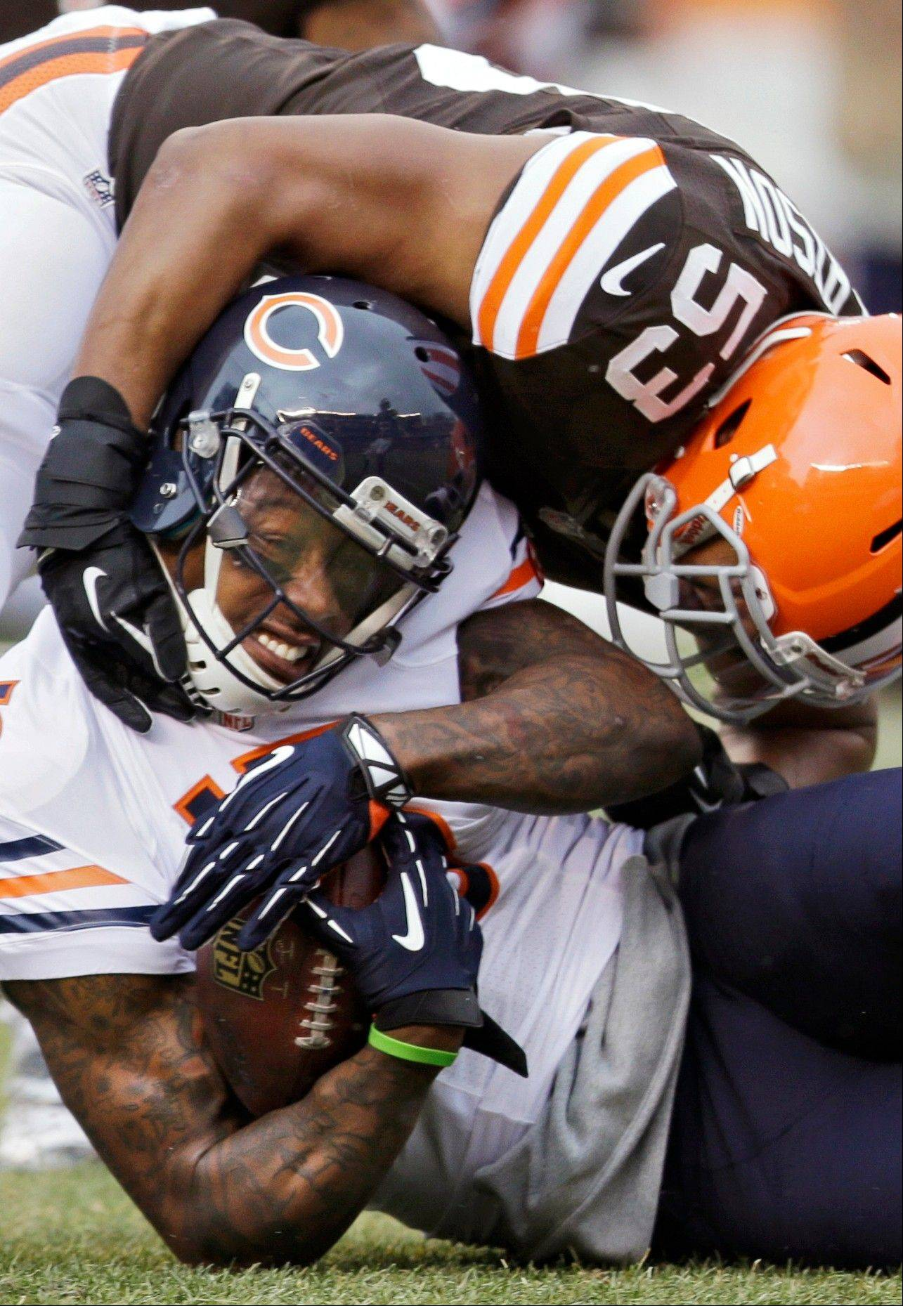Chicago Bears wide receiver Brandon Marshall (15) is tackled by Cleveland Browns inside linebacker Craig Robertson (53) after a catch in the first quarter.