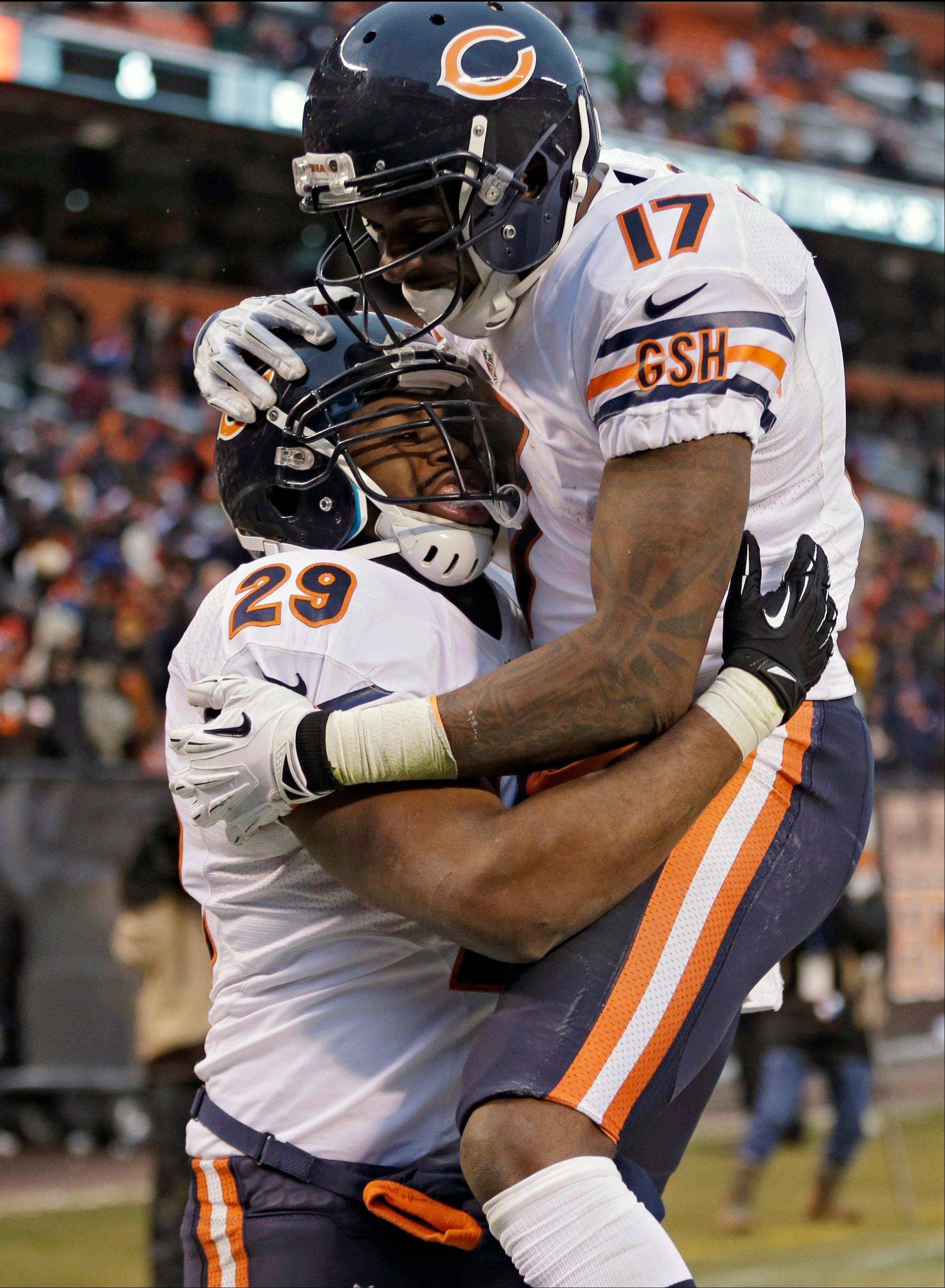 Chicago Bears running back Michael Bush (29) celebrates with wide receiver Alshon Jeffery (17) after Bush ran 40 yards for a touchdown against the Cleveland Browns in the fourth quarter of an NFL football game Sunday, Dec. 15, 2013, in Cleveland. The Bears won 38-31.