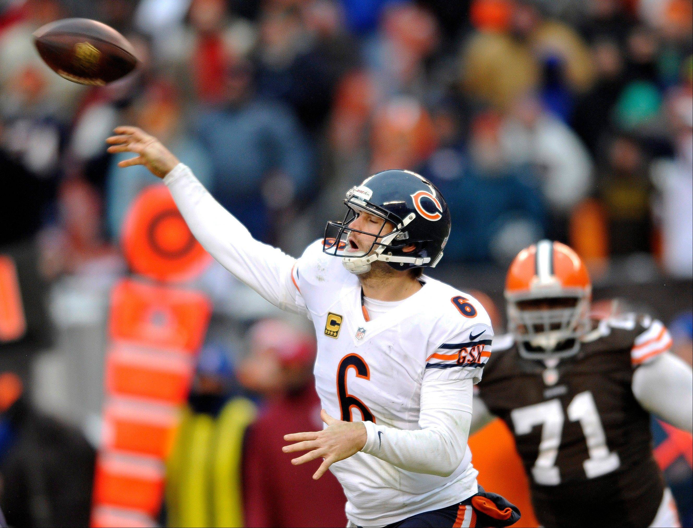 Chicago Bears quarterback Jay Cutler passes during the fourth quarter under pressure from Cleveland Browns defensive end Ahtyba Rubin.