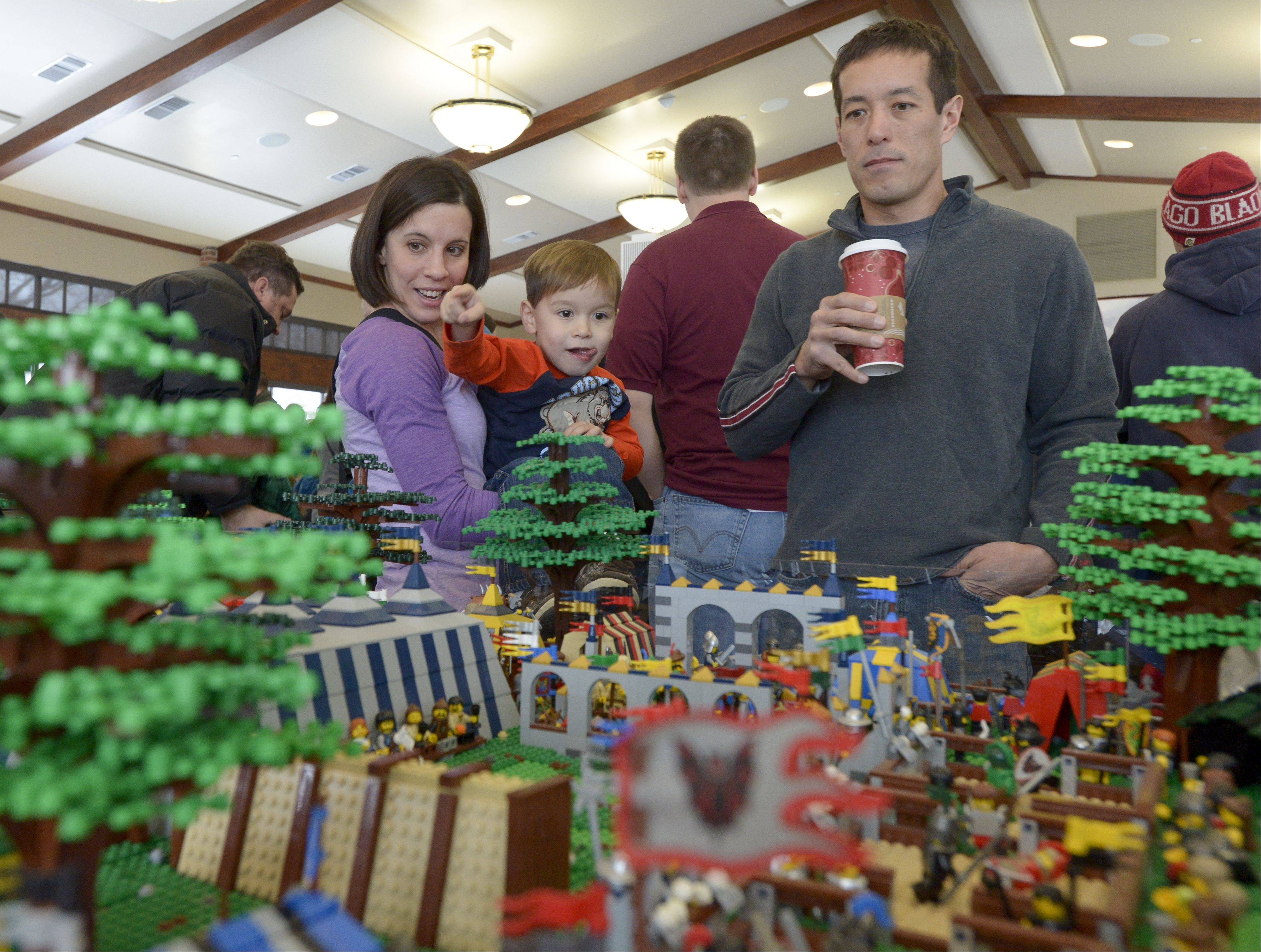The Waterstraat family of Naperville, Liz, Max, 3 and Chris, check out some of the displays setup by the Northern Illinois Lego Train Club during the 12th annual Lego Train Show and Party on Sunday at Wheaton's Cantigny Park.