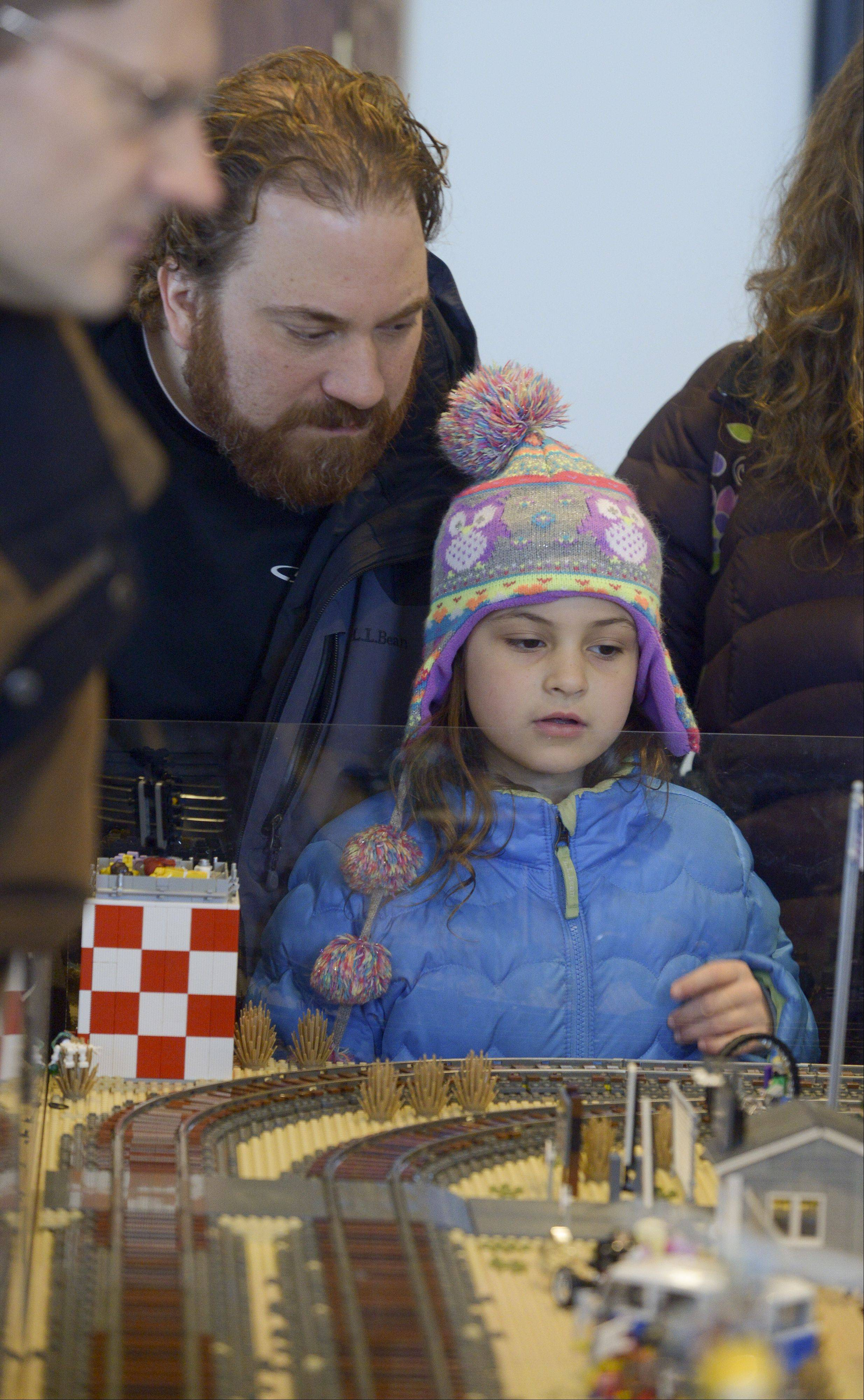 Albert Marquez of St. Charles and his daughter Penelope, 11, check out some of the Lego displays setup by the Northern Illinois Lego Train Club during their 12th annual Lego Train Show and Party on Sunday at Wheaton's Cantigny Park.