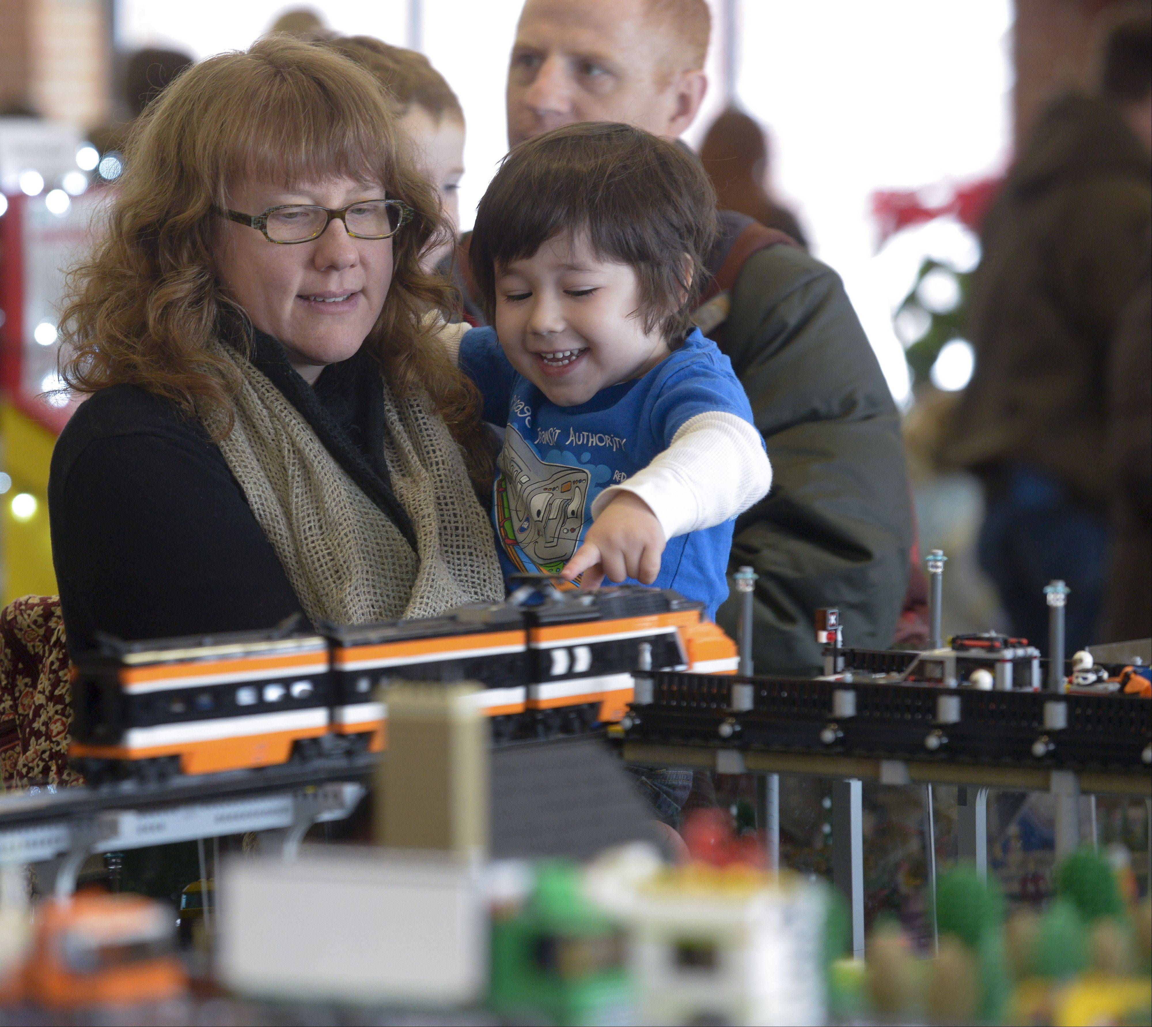 Elizabeth Cruz of Chicago holds her son Noah, 4 as they check out some of the Lego displays setup by the Northern Illinois Lego Train Club during their 12th annual Lego Train Show and Party on Sunday at Wheaton's Cantigny Park.