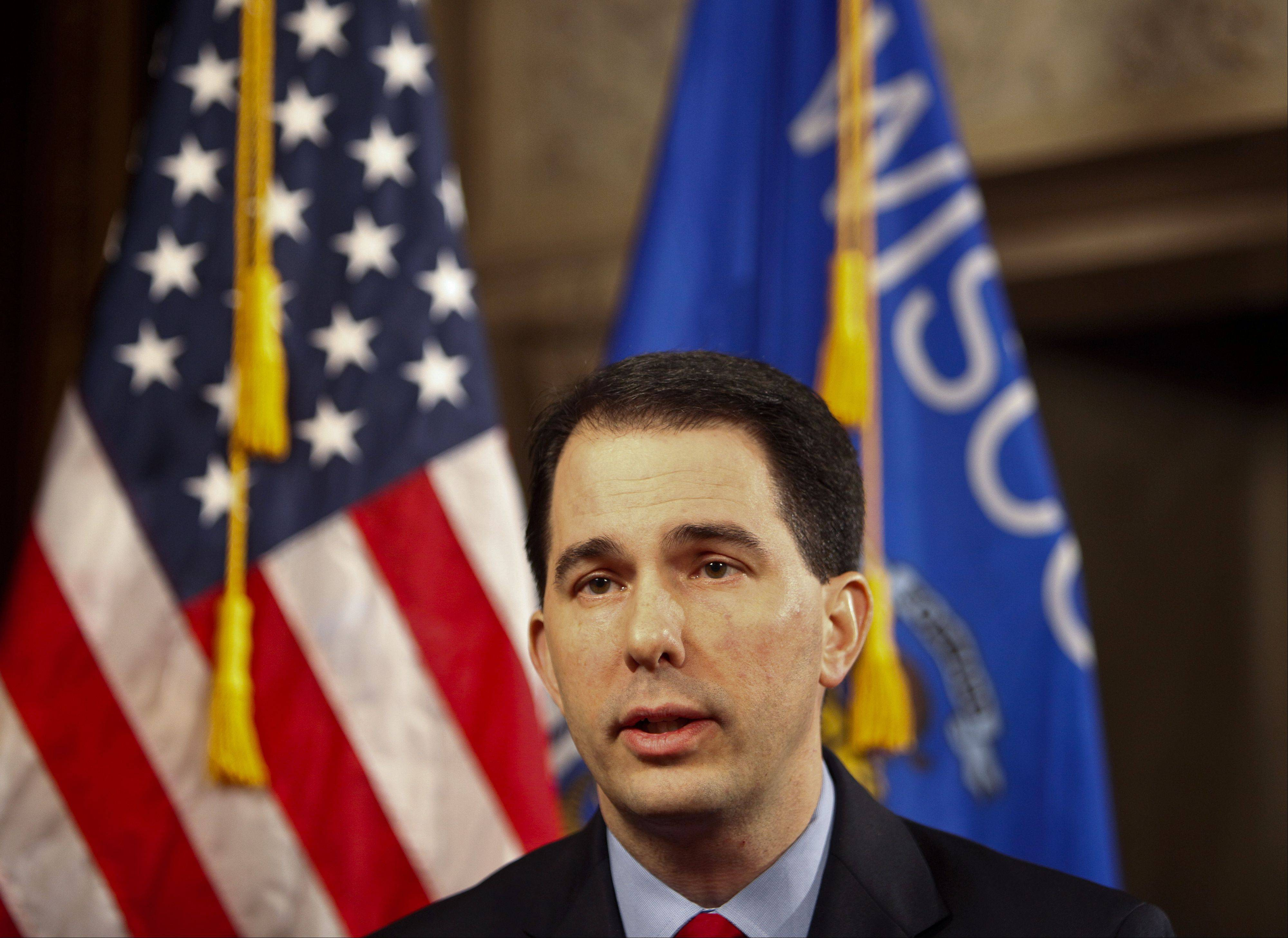 Wisconsin Gov. Scott Walker is praising fellow Wisconsin Republican Paul Ryan for the congressman's role in broking a bipartisan budget bill that's been blasted a by number of conservatives.