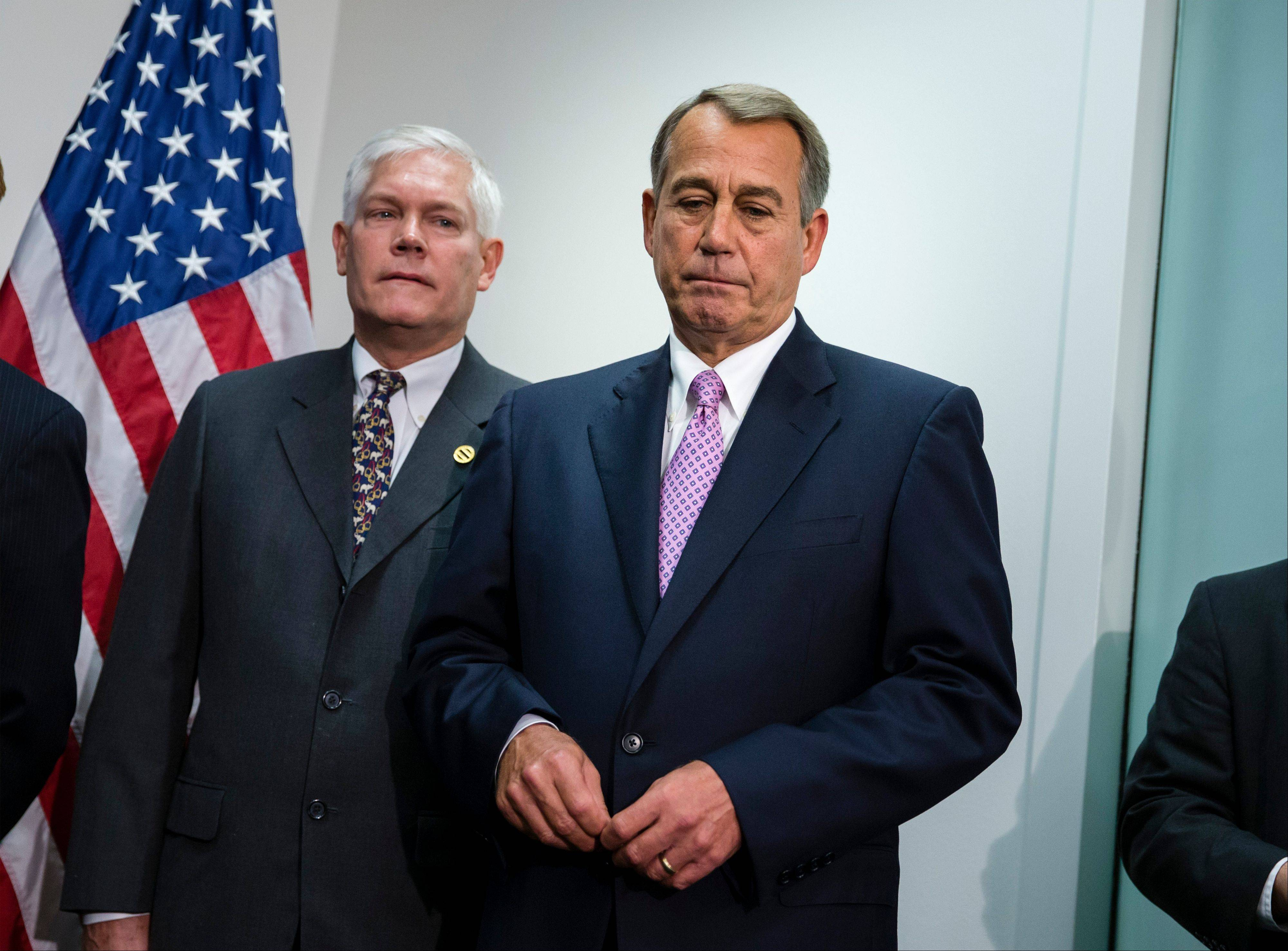 In this Oct. 4, 2013 file photo, Speaker of the House John Boehner, R-Ohio, is joined by Rep. Pete Sessions, R-Texas, left, during a news conference at the Capitol. People hoping for a better-functioning government canít decide whether to cheer or lament Congressí bipartisan budget bill. Legislative leaders call a breakthrough even as they acknowledge it does little.