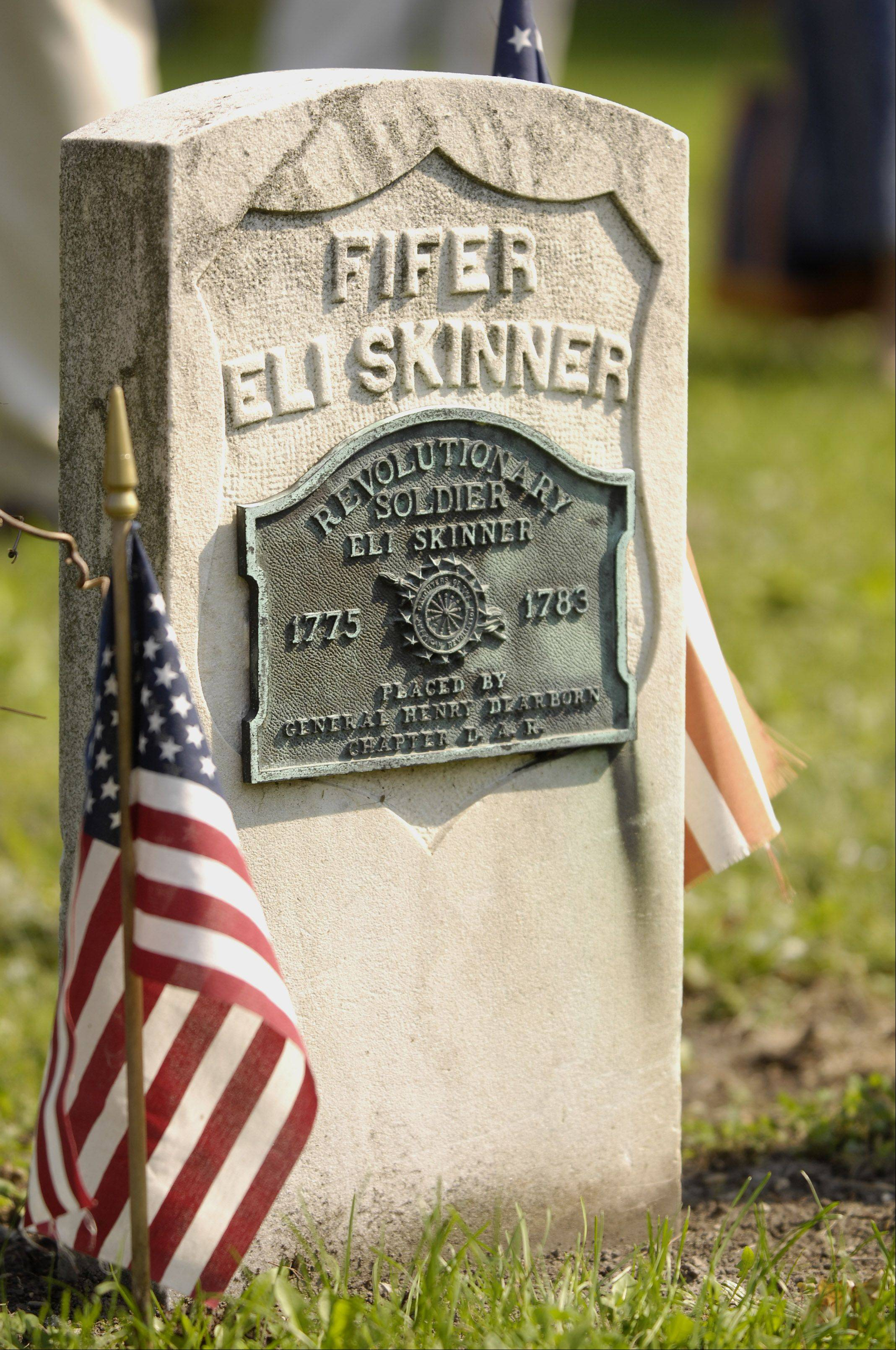 A gravestone at Elk Grove Cemetery recognizes Revolutionary War veteran Eli Skinner. The Illinois Sons of the American Revolution plan to install a historical marker at the cemetery to recognize Skinner and another Revolutionary War figure, Aaron Miner, who is also buried there.
