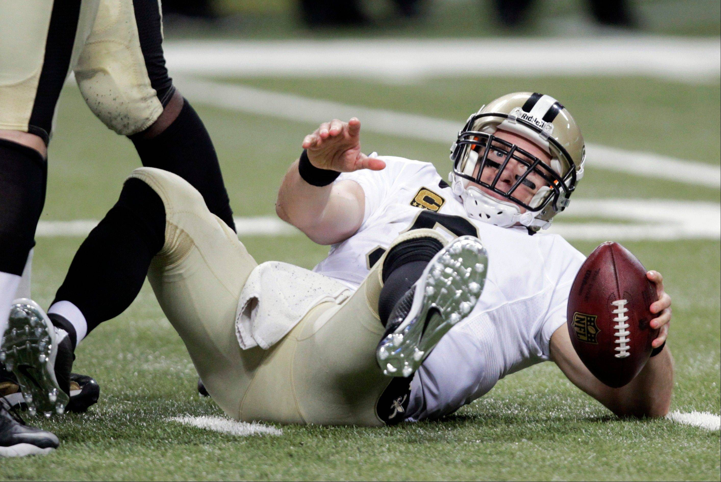 New Orleans Saints quarterback Drew Brees gets up slowly after being sacked for a 6-yard loss by St. Louis Rams defensive end William Hayes during the fourth quarter of an NFL football game Sunday, Dec. 15, 2013, in St. Louis. The Rams won 27-16.
