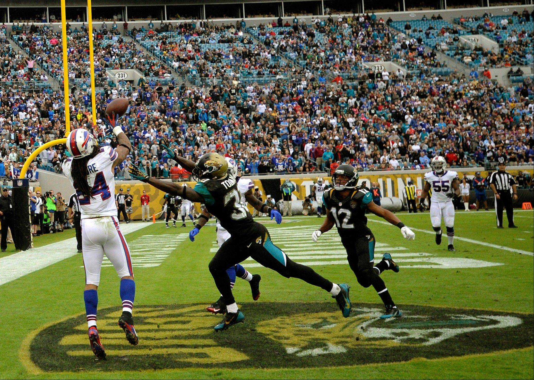 Buffalo Bills cornerback Stephon Gilmore (24) intercepts a pass in the end zone intended for Jacksonville Jaguars running back Jordan Todman (30) during the second half of an NFL football game, Sunday, Dec. 15, 2013, in Jacksonville, Fla. The Bills beat the Jaguars 27-20.
