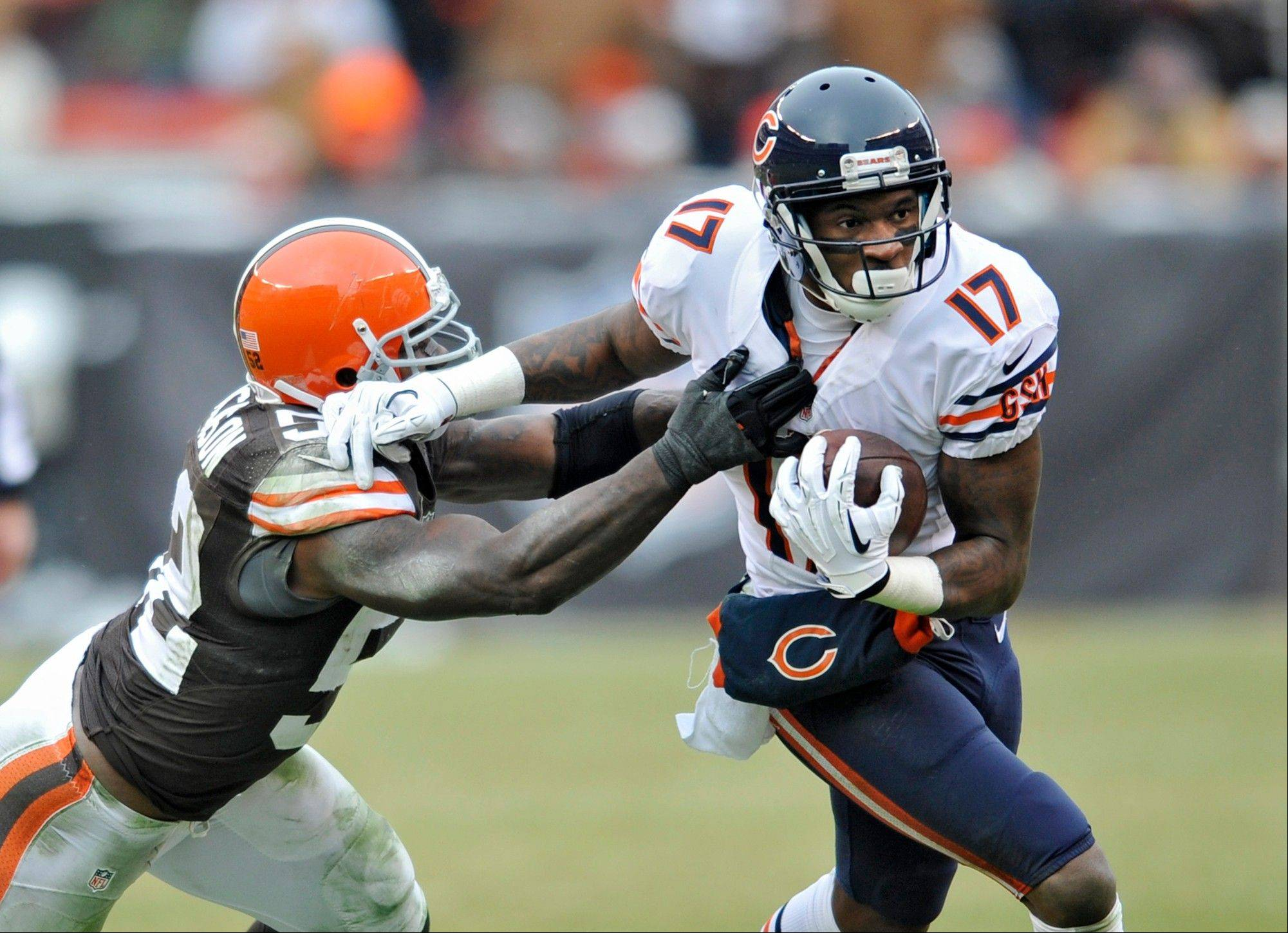 Bears wide receiver Alshon Jeffery (17) fights off Cleveland Browns inside linebacker D'Qwell Jackson after a catch in the second quarter of an NFL football game, Sunday, Dec. 15, 2013, in Cleveland.