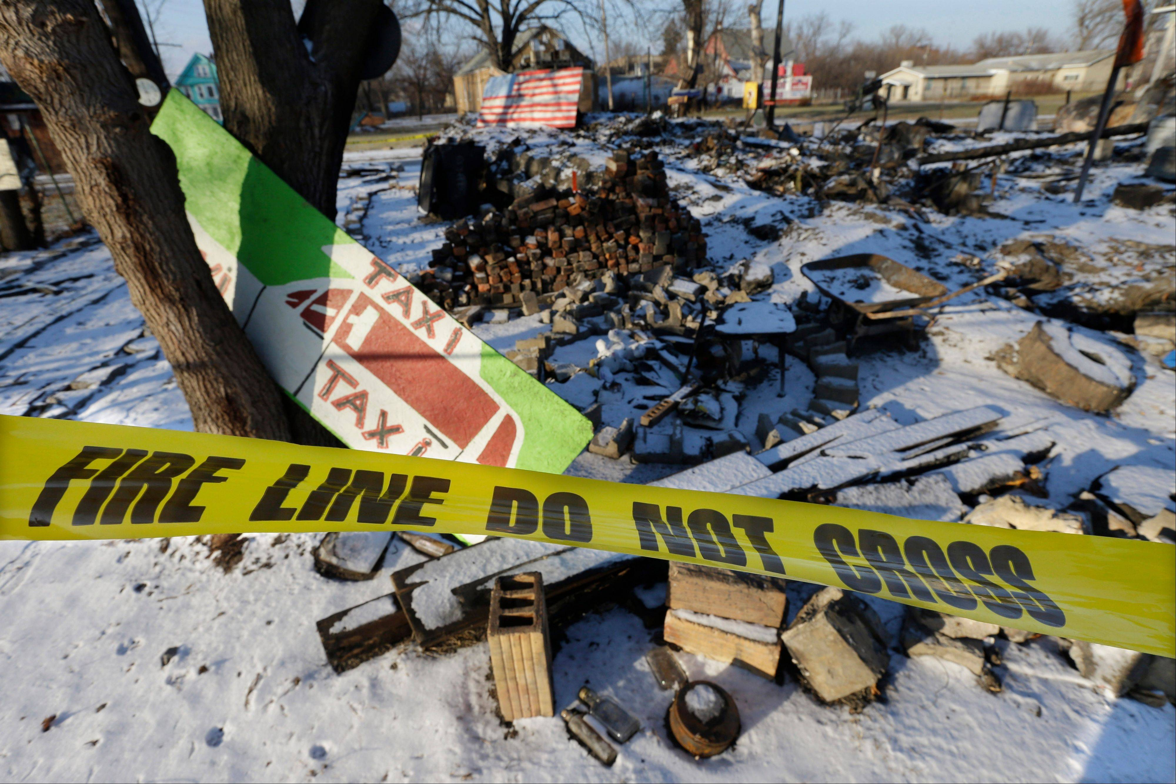 Fire tape surrounds the aftermath of the fire at the House of Soul at Detroit�s Heidelberg Project. There have been at least eight fires since early May, leading to questions about who might be targeting the installation and why they want to burn it down. Founder and artistic director Tyree Guyton and his compatriots vow to carry on, make more art and overcome the assault on his vision, yet worry threatens the whimsy as the fires snuff out building after building.