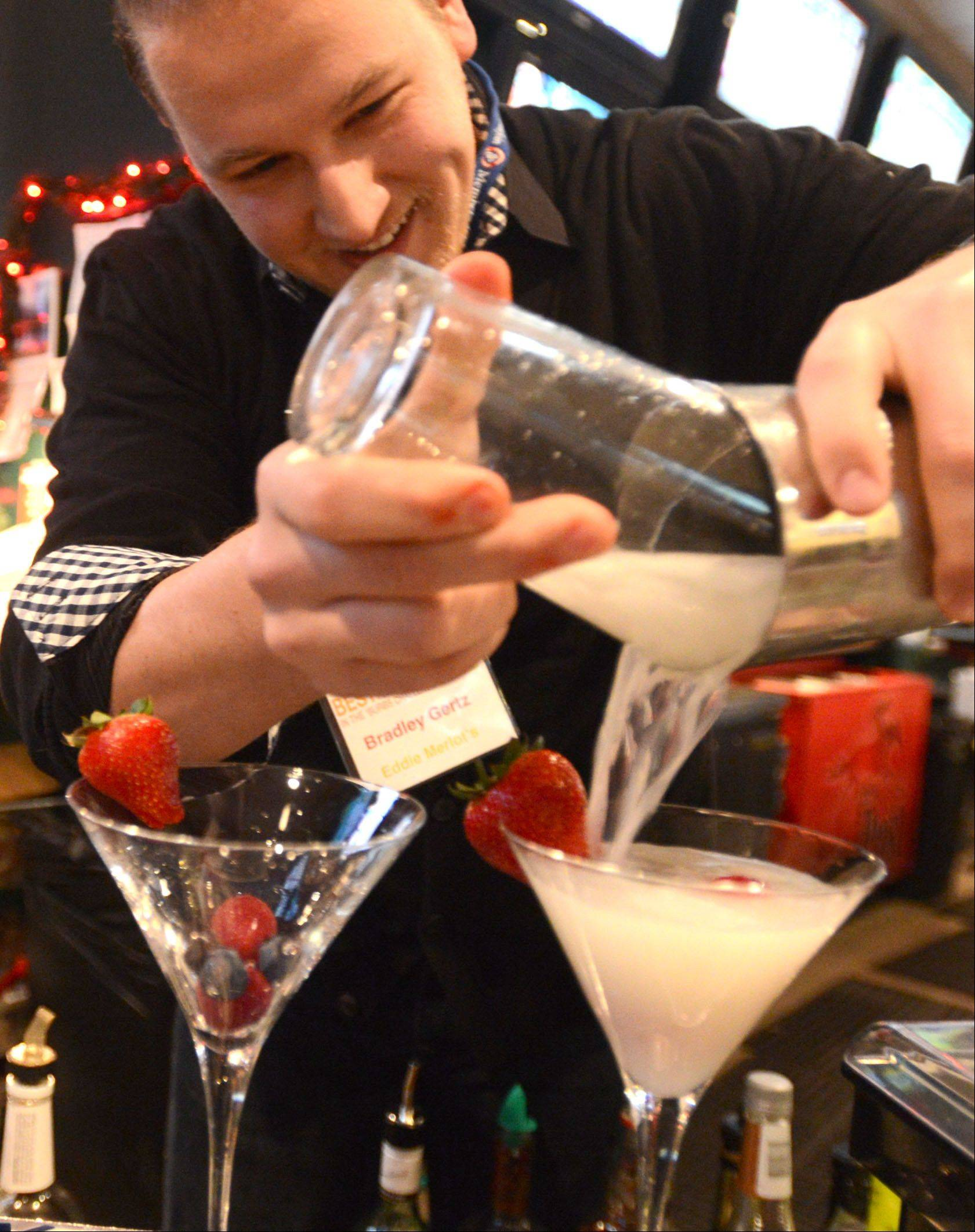 Mixologist Bradley Gertz of Eddie Merlot�s Lincolnshire restaurant prepares the Berry White Martini during the Daily Herald�s Best Martini in the �Burbs Challenge at the At The Post Sports Bar & OTB in Elk Grove Village on Monday night.