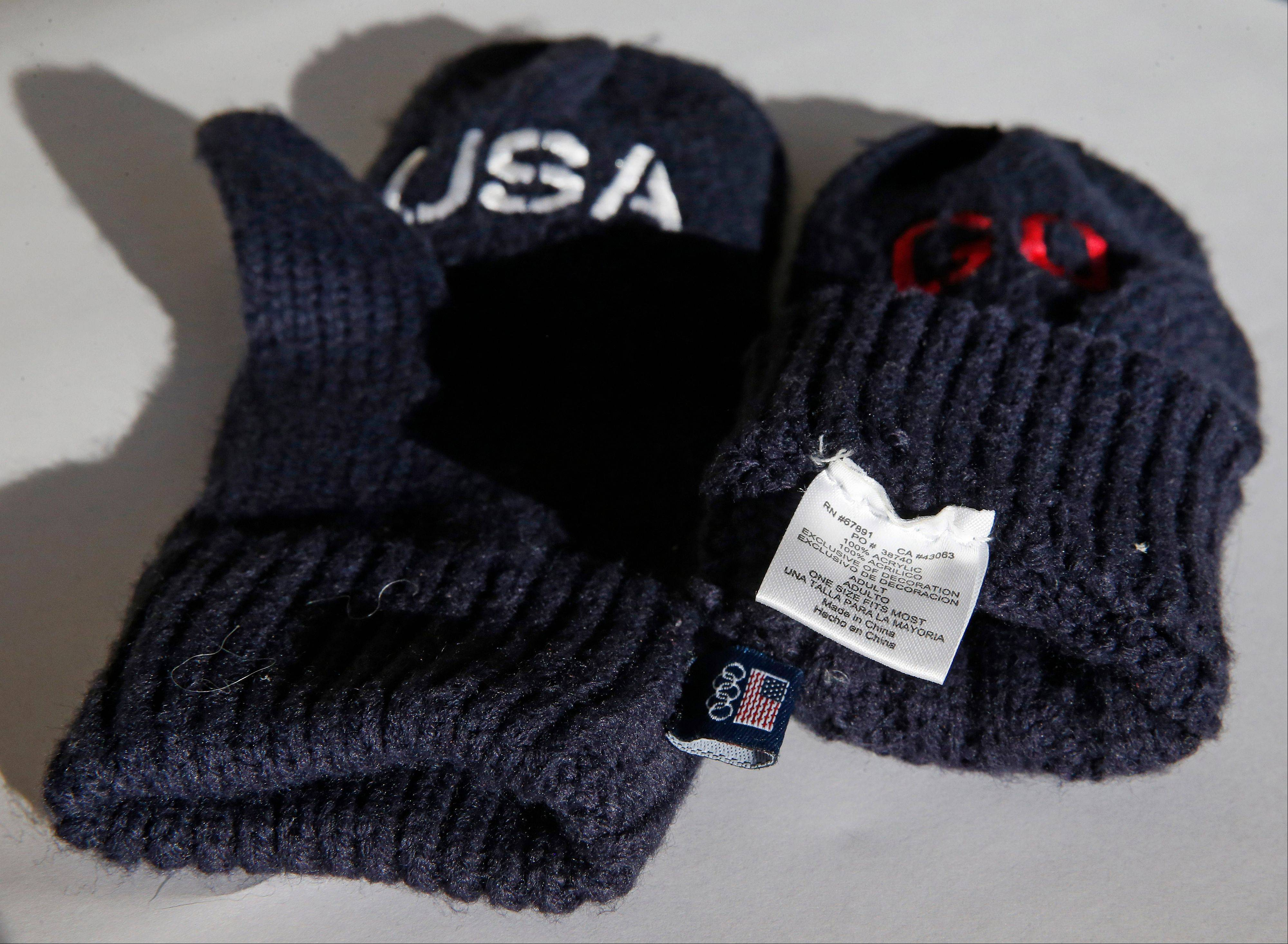 The U.S. Olympic Committee is charging $14 a pair for the blue gloves that have the word �Go� embroidered in red on one mitten and �USA� on the other. The pair is also labeled with a tag on the inside which says the gloves are �Made in China.�