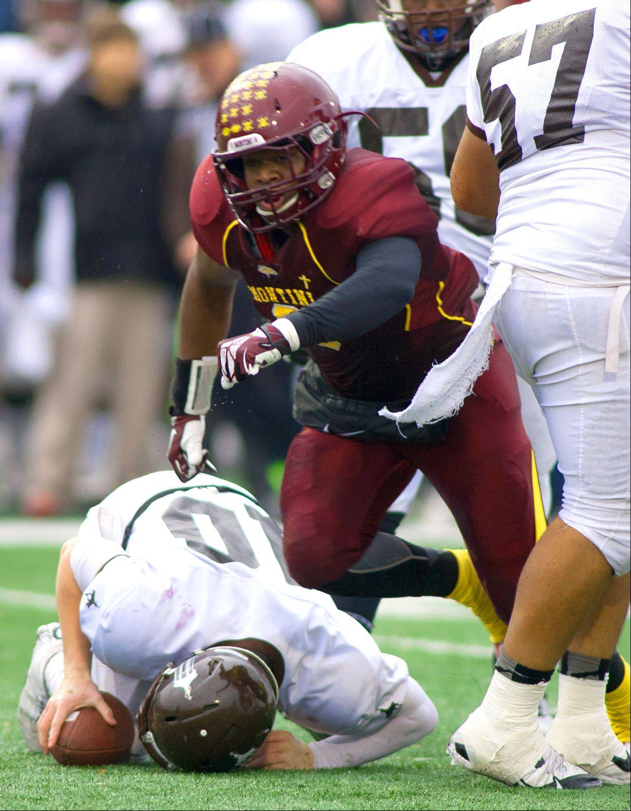 Montini Catholic�s Niles Sykes celebrates a sack against Joliet Catholic quarterback Nick Morrison.
