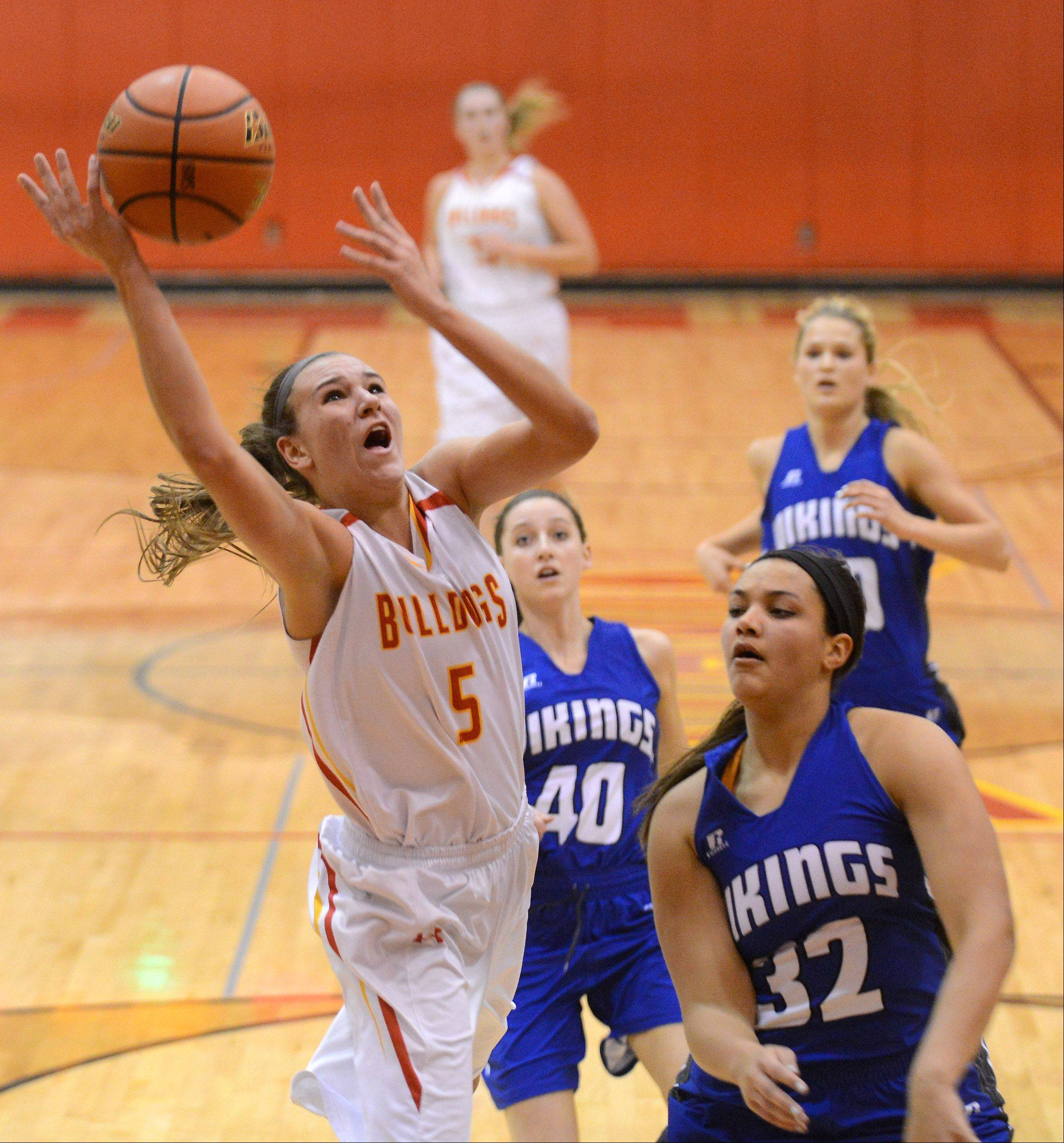Batavia�s Liza Fruendt (5) shoots and scores in front of Geneva�s Sidney Santos (32) during Friday�s game in Batavia.