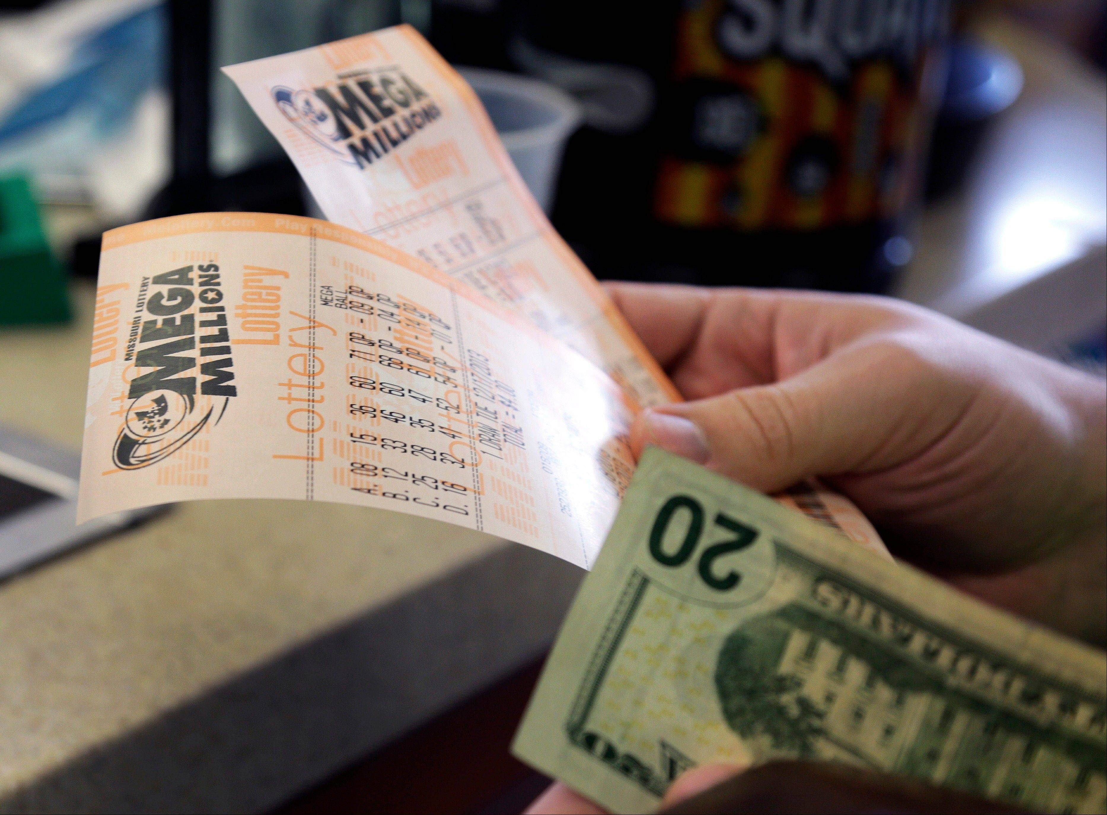 The Mega Millions jackpot soared to $586 million on Monday amid a frenzy of ticket purchases, a jump that pushed the prize closer to the $656 million U.S. record set last year.