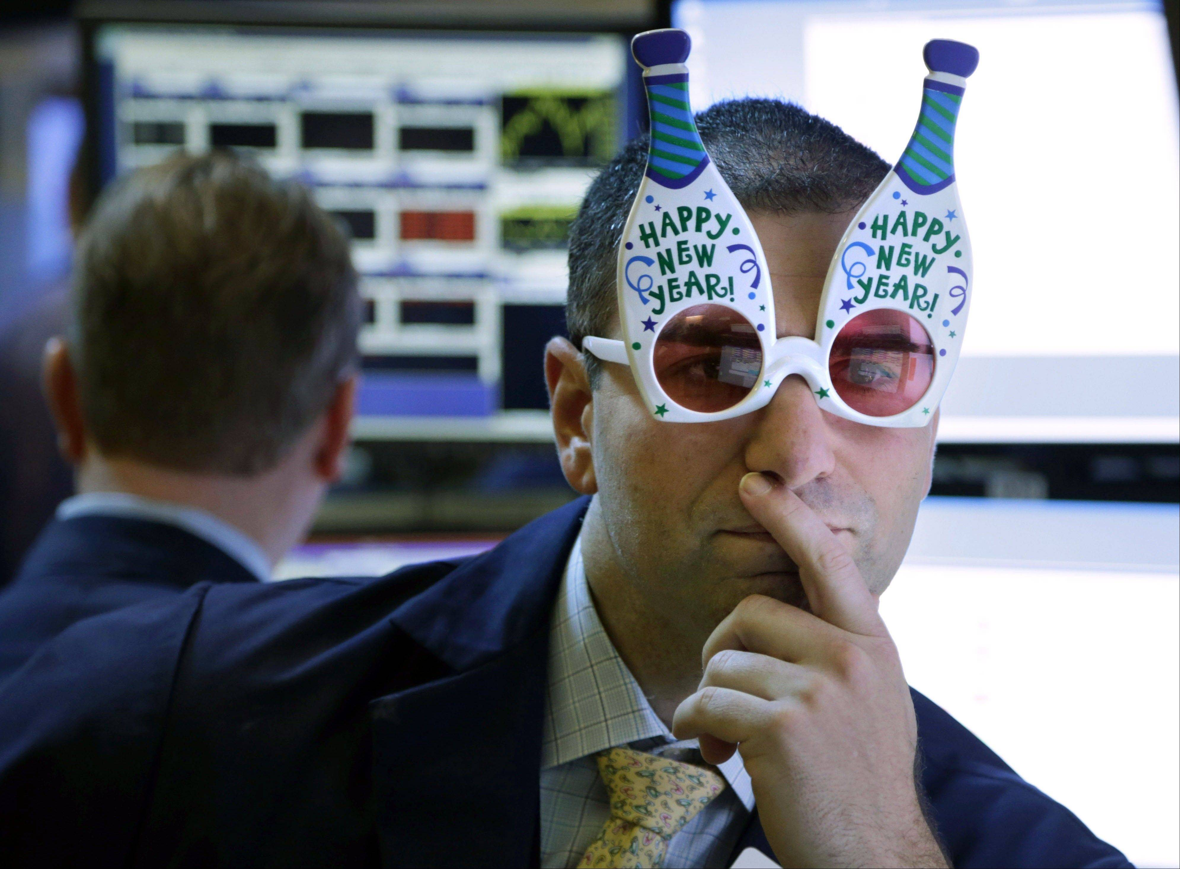 "A trader wearing ""Happy New Year"" glasses works on the floor at the New York Stock Exchange in New York. According to an Associated Press-GfK poll released Monday, Americans don't expect another gangbuster year for the stock market."