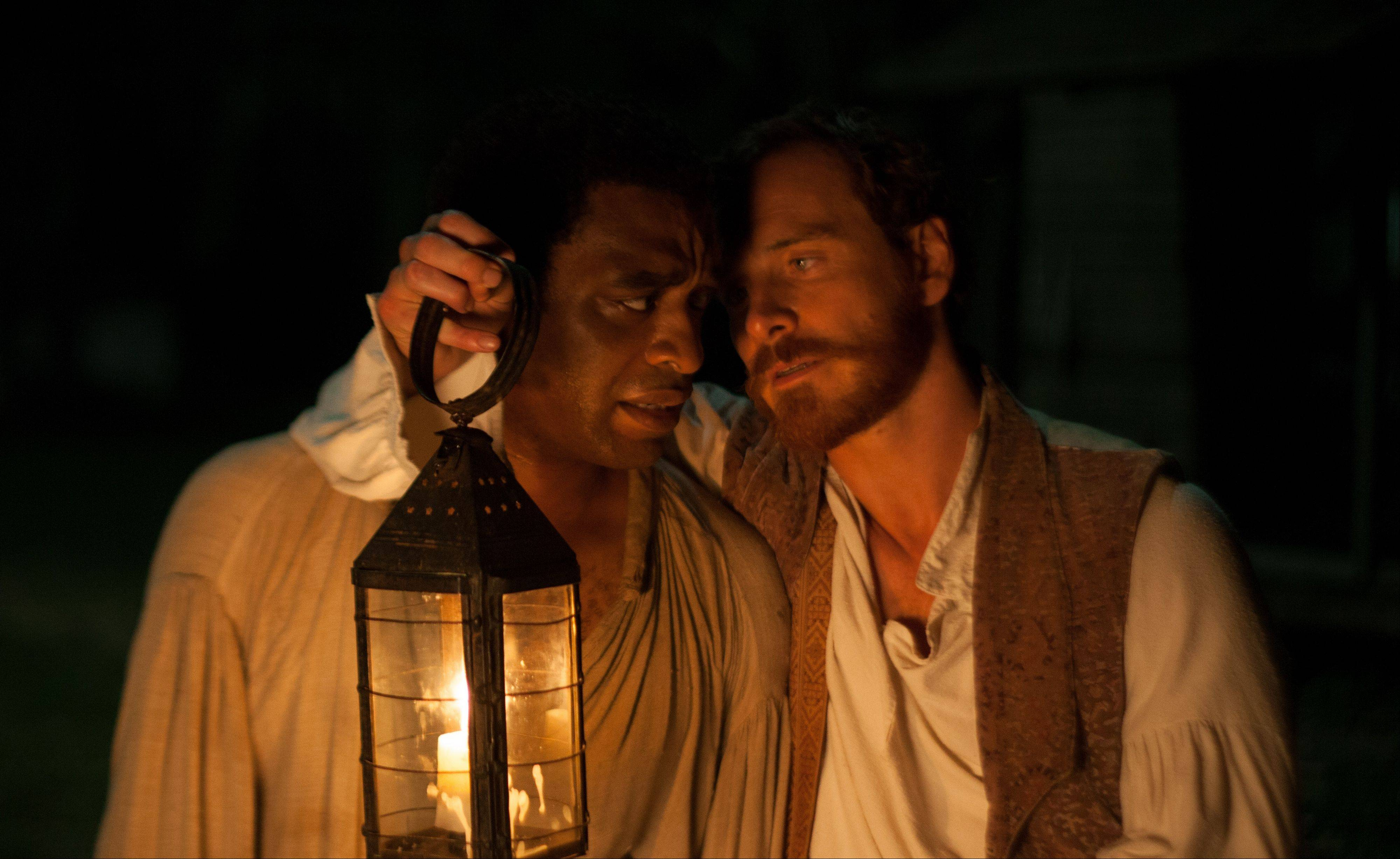 "Chicago Film Critics named Chiwetel Ejiofor, left, best actor of 2013 for his searing portrait of a kidnapped free man in Steve McQueen's ""12 Years A Slave,"" which won best picture. Best supporting actor nominee Michael Fassbender is at right."