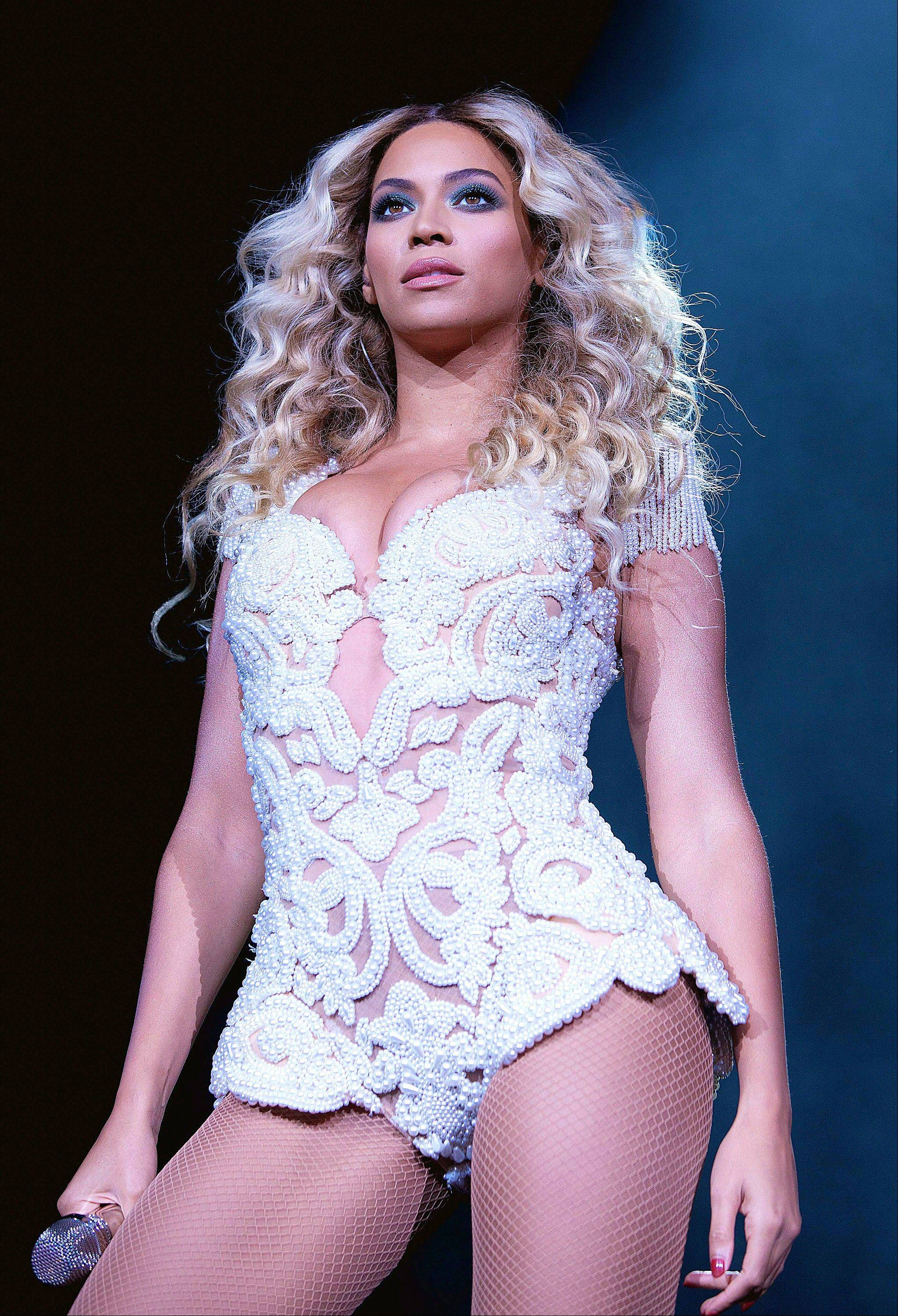 "Beyoncé during her ""Mrs. Carter Show World Tour 2013"" at the American Airlines Center in Dallas."