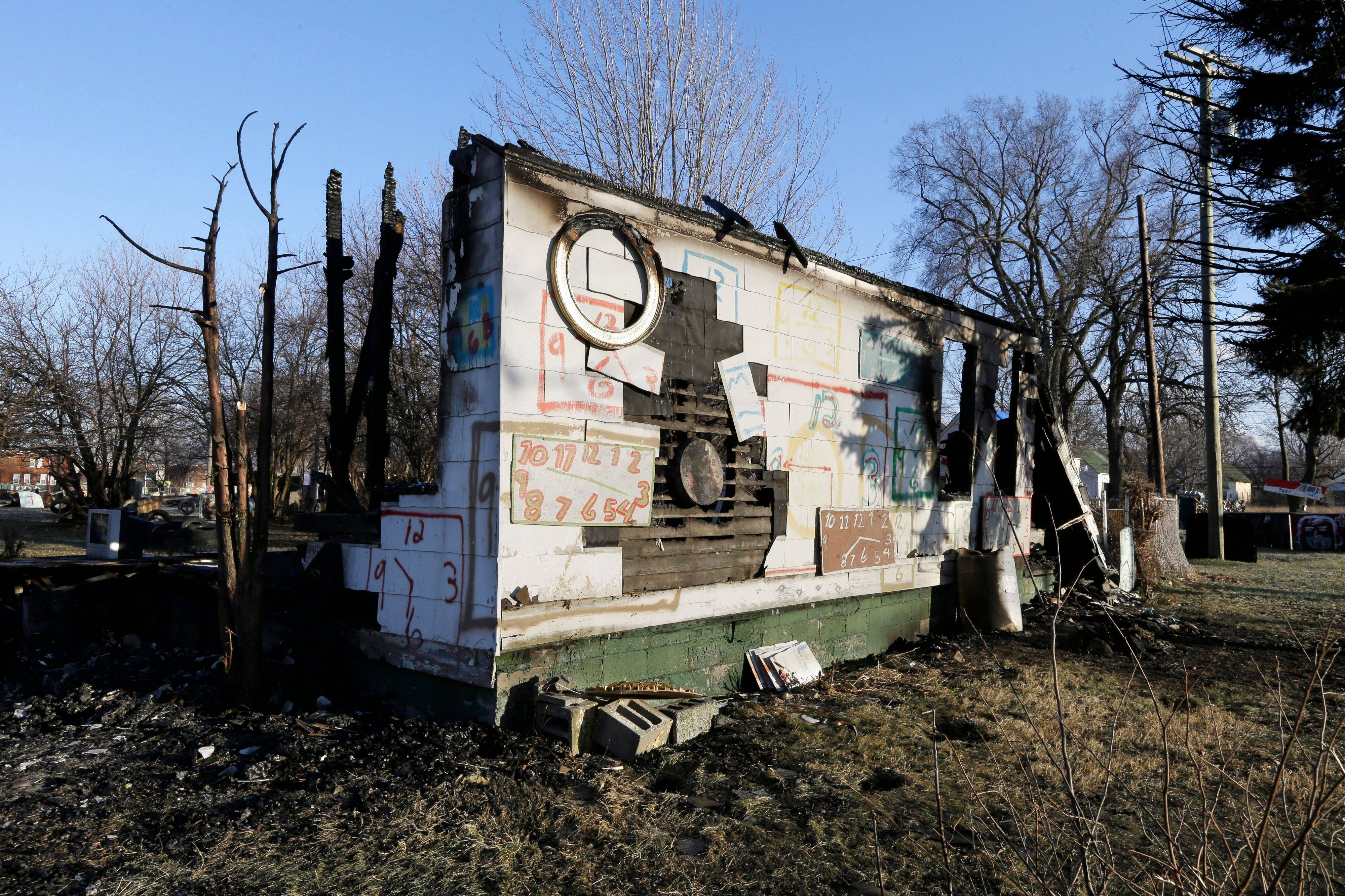 This is all that remains of the Clock House at the Heidelberg Project in Detroit. There have been at least eight fires since early May leading to questions about who might be targeting the installation.