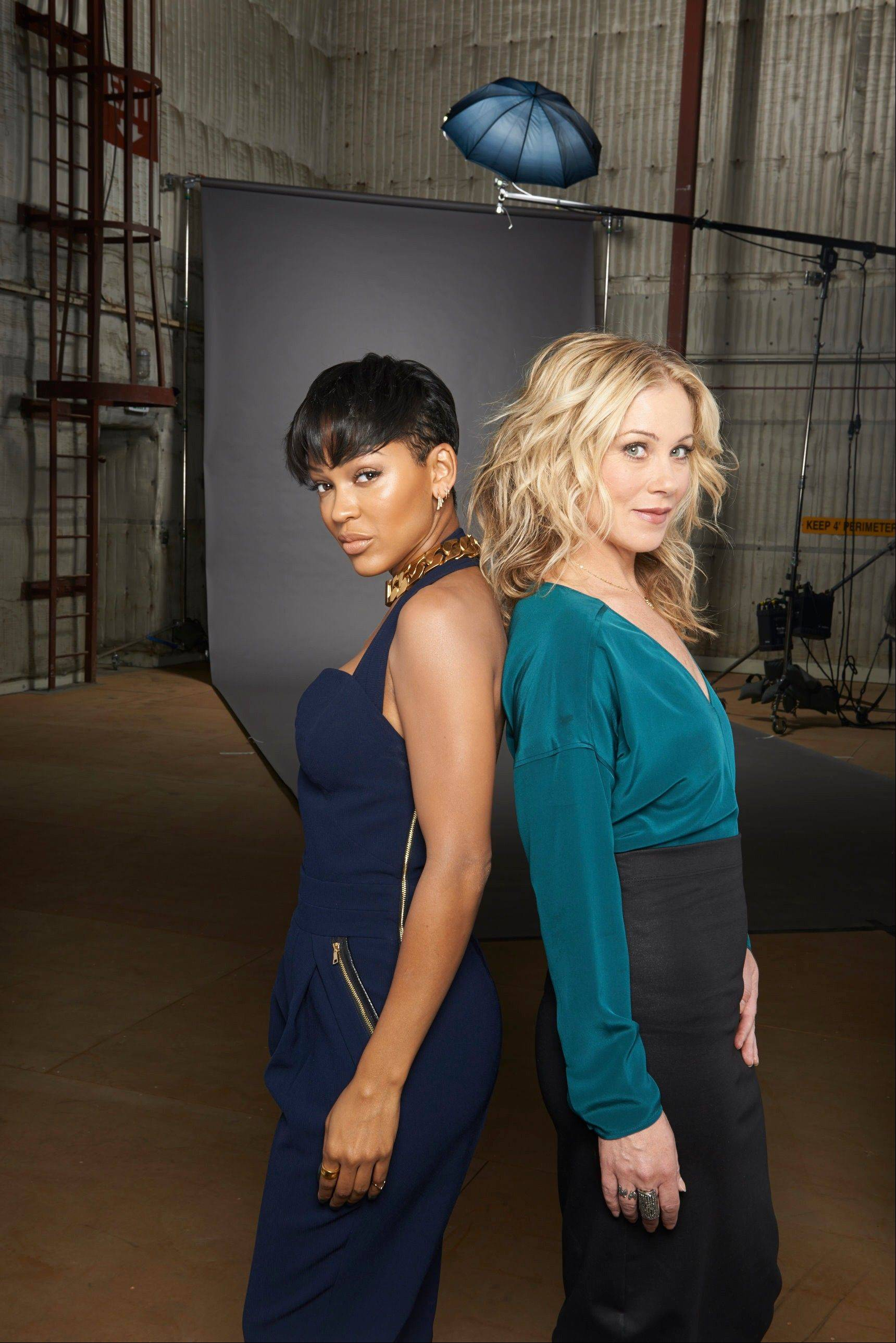 "This photo provided by Paramount Pictures shows, actresses Meagan Good, left, and Christina Applegate, on the Paramount Lot in the Hollywood section of Los Angeles. Good, Applegate, and Kristen Wiig star in ""Anchorman 2: The Legend Continues,"" releasing in the US on Dec. 18, 2013."