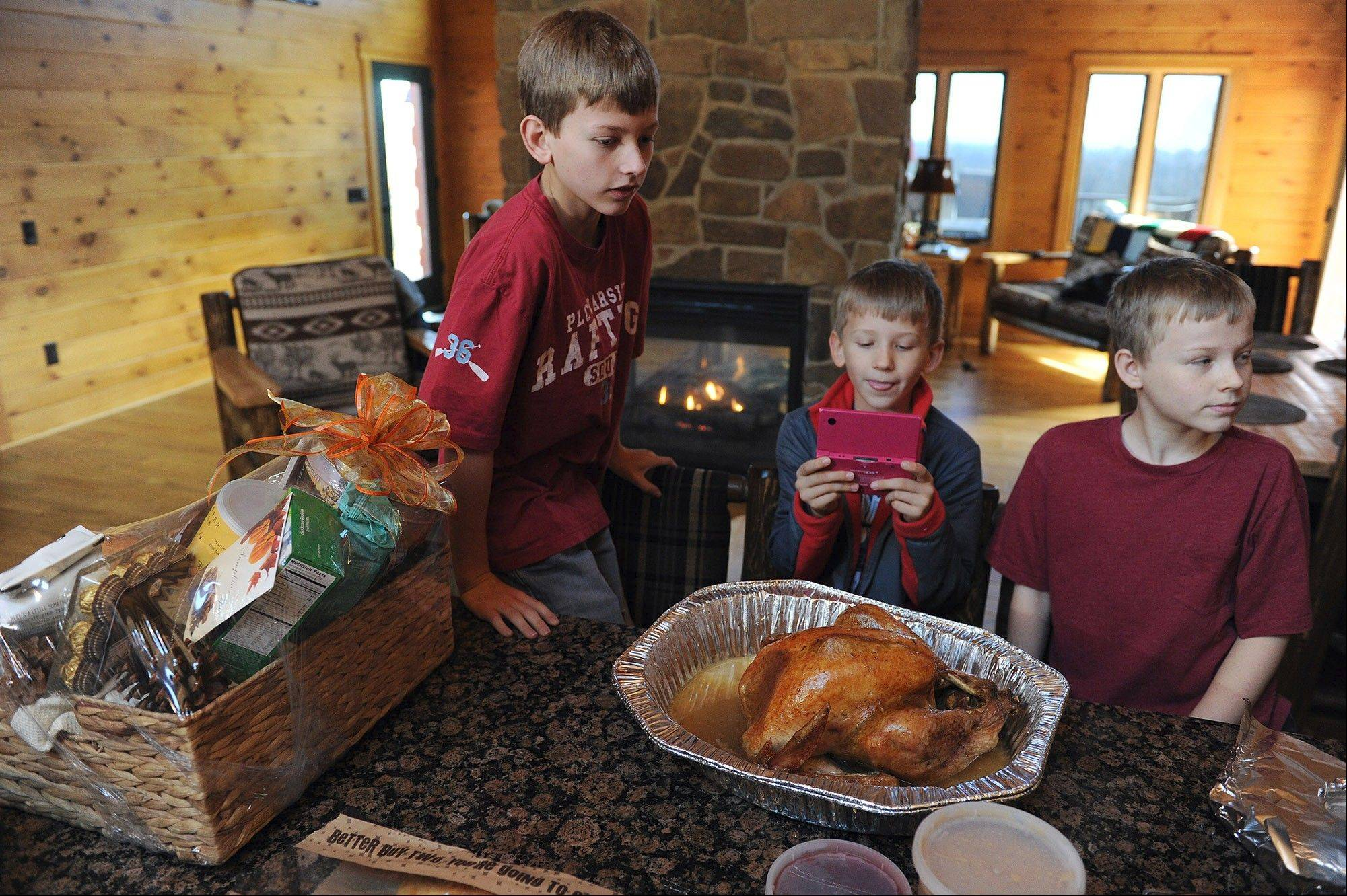 From left, brothers Lucas Zajdel, Cole Zajdel and Wyatt Zajdel wait to eat a Thanksgiving meal provided by Boulder Crest Retreat in Bluemont, Va. Their mother, Liza Kazee, was in the Air Force. Her husband, Matt Kazee, is in the Navy.