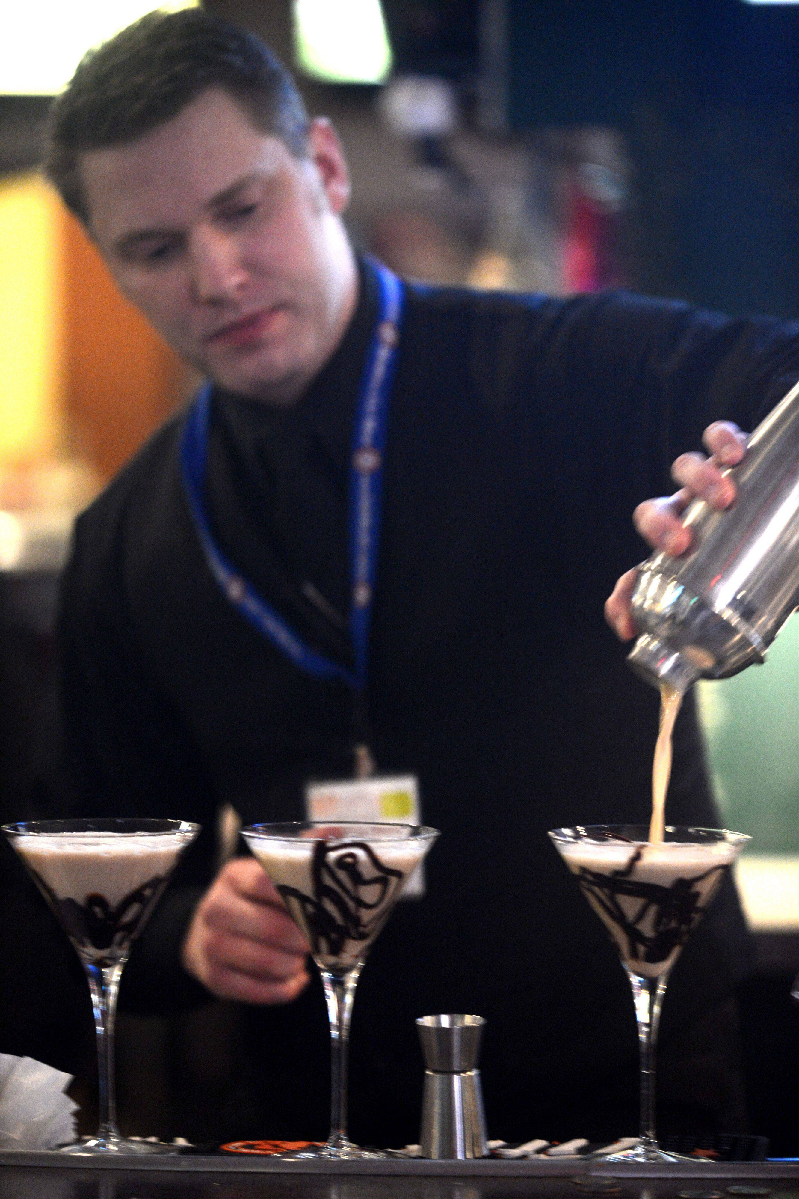 Joshua Olson of Chicago Prime Steakhouse prepares the Chocolate Love Martini during the Daily Herald's Best Martini in the 'Burbs Challenge at the At The Post Sports Bar & OTB in Elk Grove Village on Monday night.