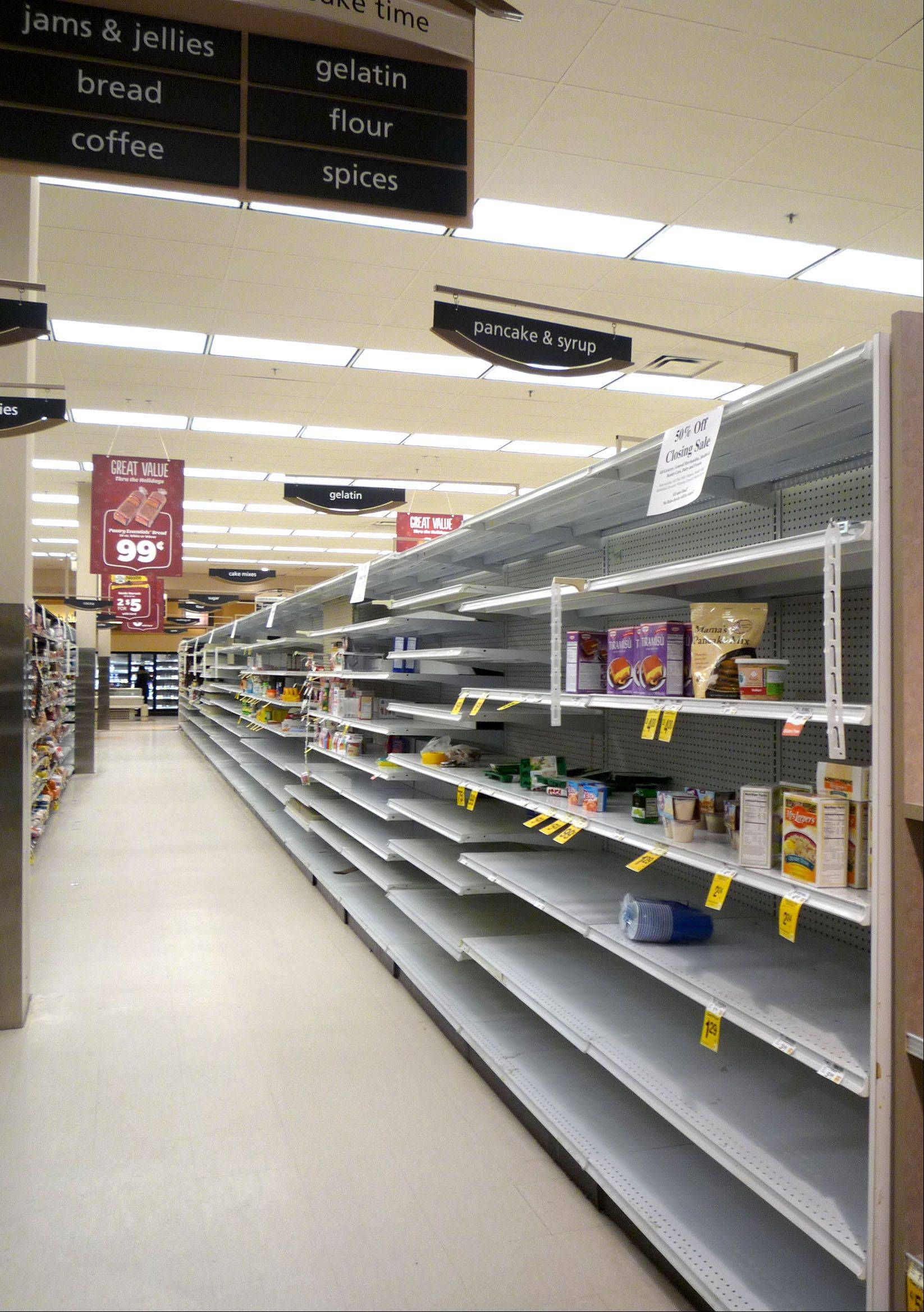 The shelves at the Arlington Heights Dominick's store are empty on Monday as the chain prepares to wind down business at its suburban stores by Dec. 28.