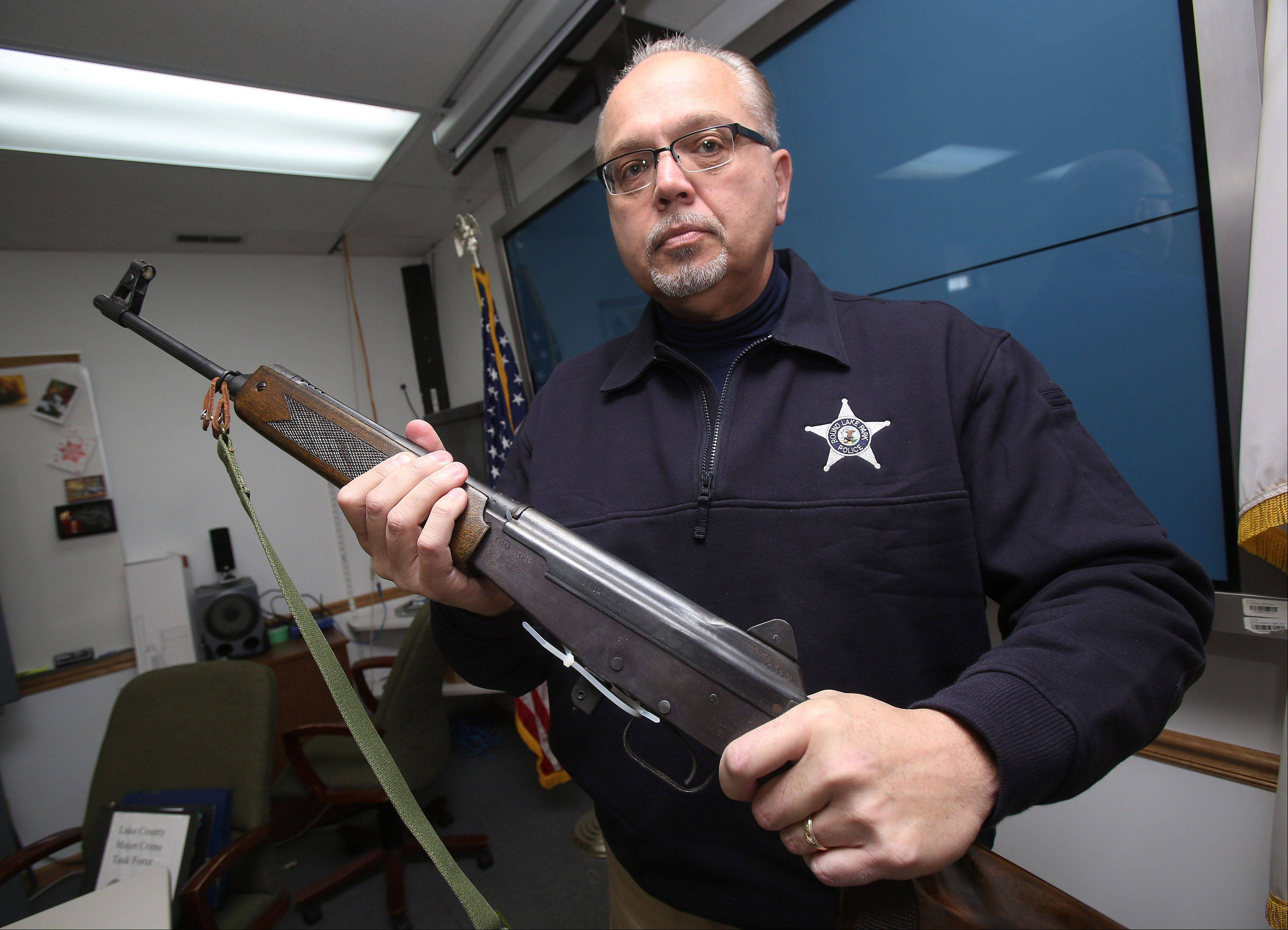 Round Lake Park Police Chief George Filenko says the seemingly low number of Firearm Owner's Identification cards issued to addresses in his village doesn't take into account illegal guns, such as this modified AK-47 assault rifle that's being held in police storage.