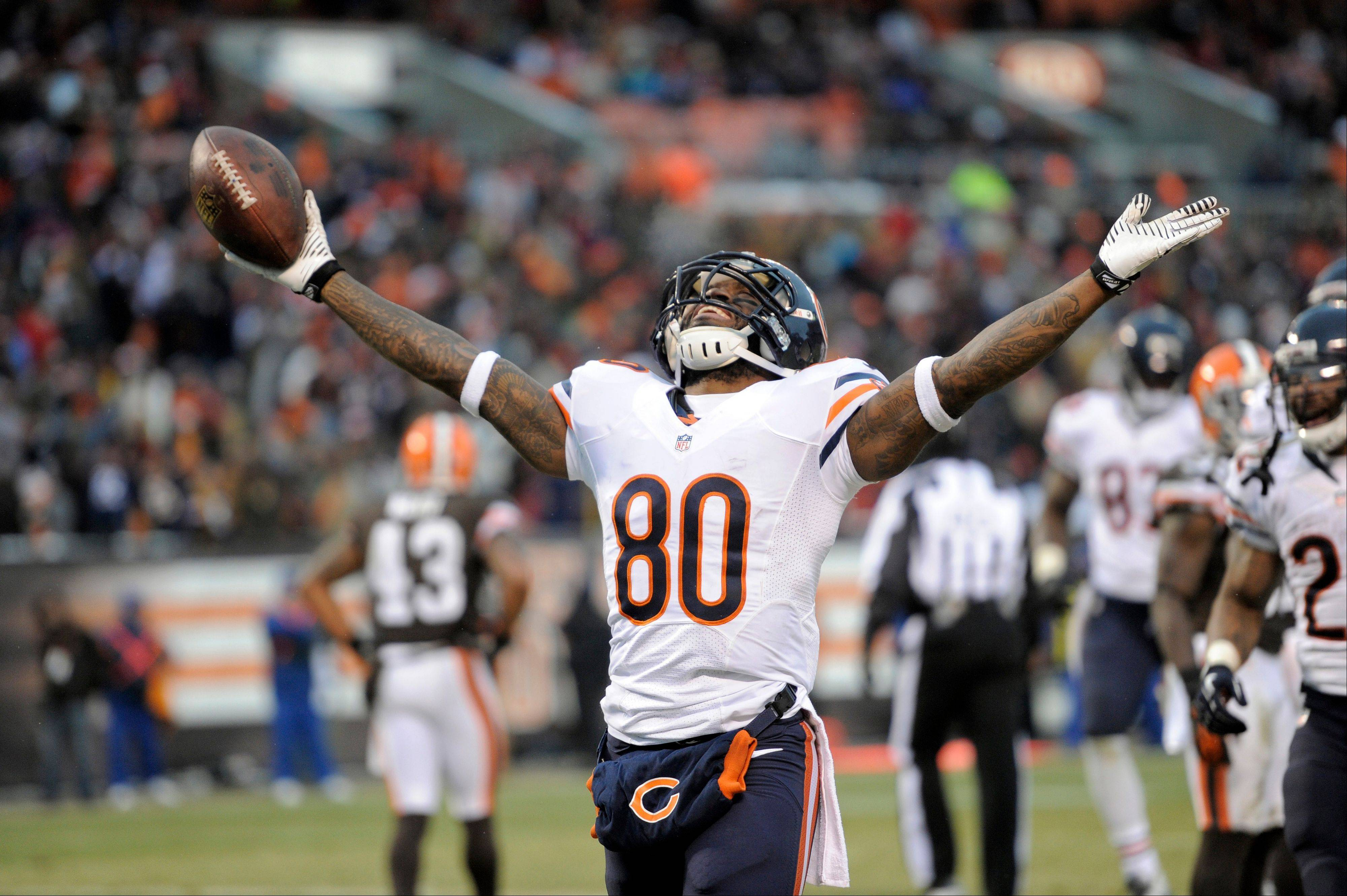 Chicago Bears wide receiver Earl Bennett celebrates after catching a four-yard touchdown pass against the Cleveland Browns in the fourth quarter of an NFL football game Sunday in Cleveland.