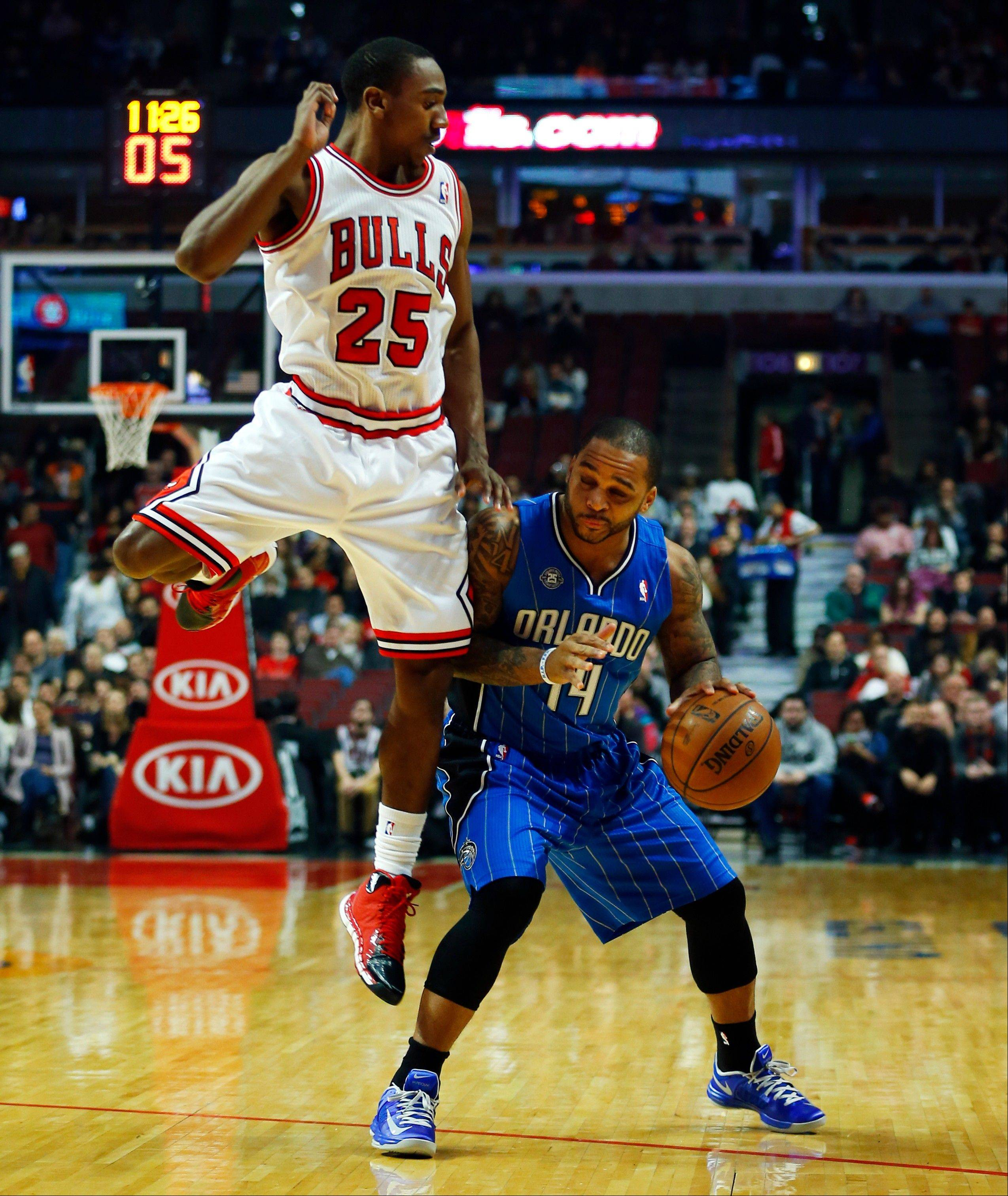 Bulls point guard Marquis Teague (25) runs into Orlando Magic point guard Jameer Nelson (14) during the first half of an NBA basketball game in Chicago on Monday, Dec. 16, 2013.