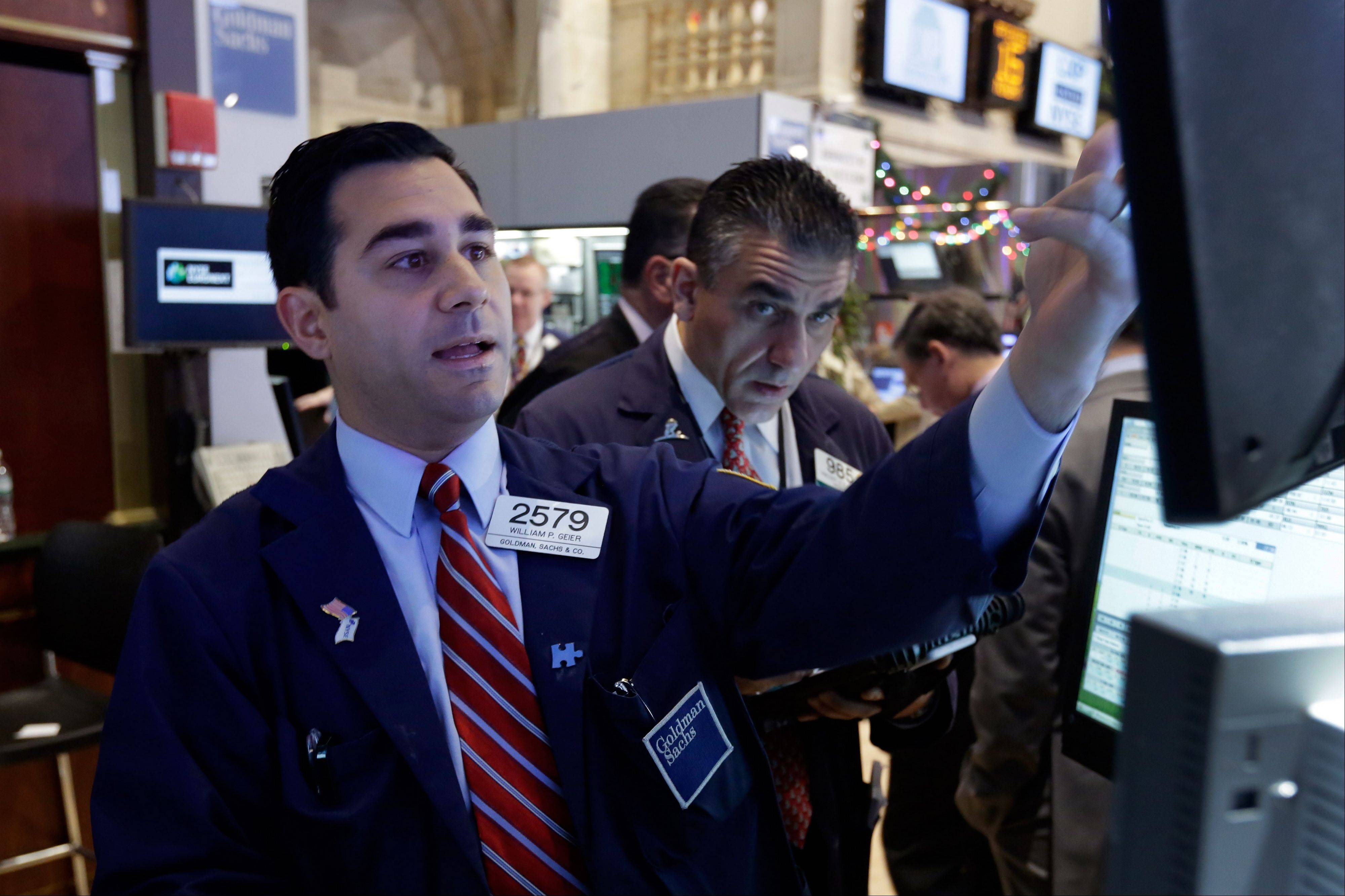 Stocks fell on Tuesday, following Monday�s rally for the Standard & Poor�s 500 Index, before Federal Reserve policy makers announce plans for their monthly bond-buying program on Wednesday.