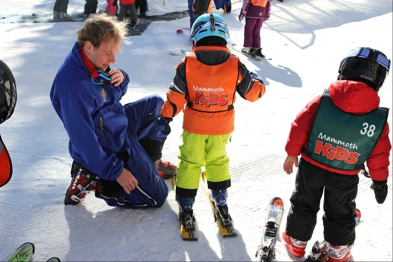 A ski instructor coaches Alex Faerber on technique at a skiing class for young children at California�s Mammoth Mountain. To help Alex master the basics, the then-4-year-old got professional instruction at Mammoth.