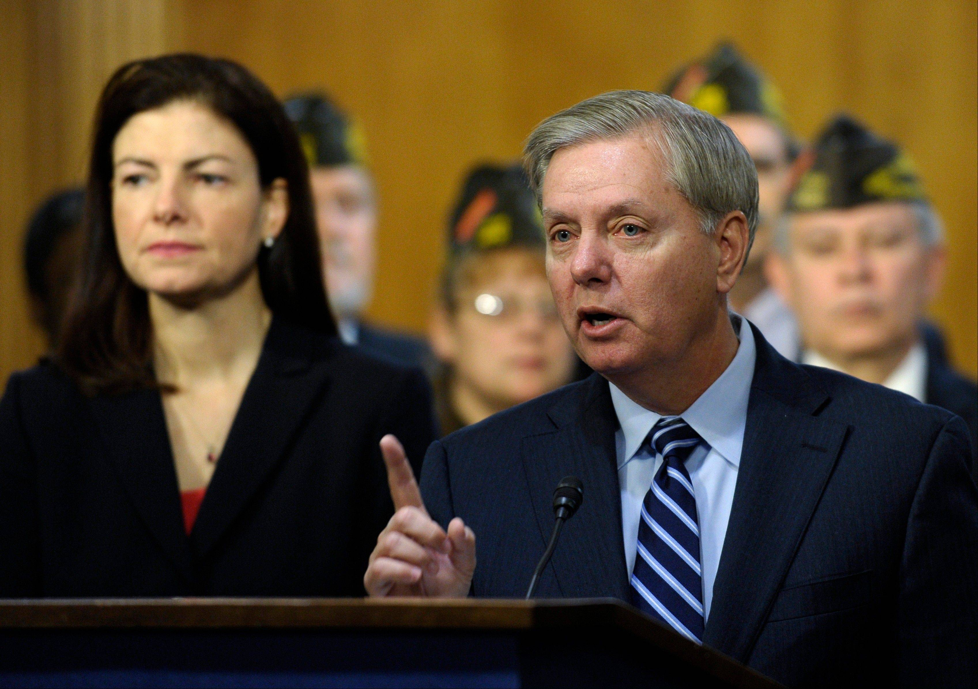 Sen. Lindsey Graham, a South Carolina Republican, right, accompanied by Sen. Kelly Ayotte, a New Hampshire Republican, urge their Senate colleagues to change the budget proposal that cuts retirement benefits for current and future military retirees prior to Tuesday�s preliminary vote.