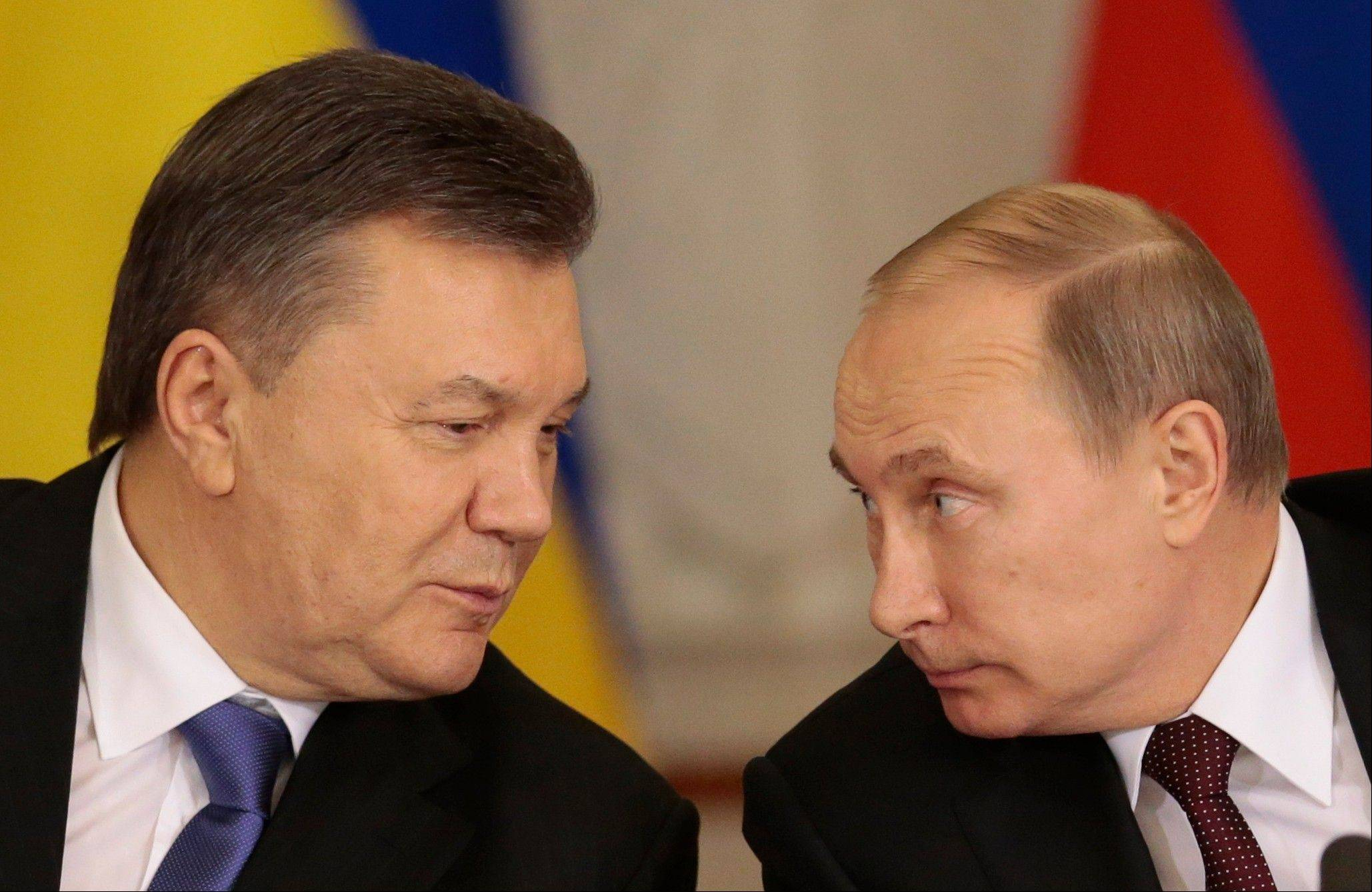Russian President Vladimir Putin, right, and his Ukrainian counterpart Viktor Yanukovych chat during a news conference after their talks in Moscow on Tuesday.