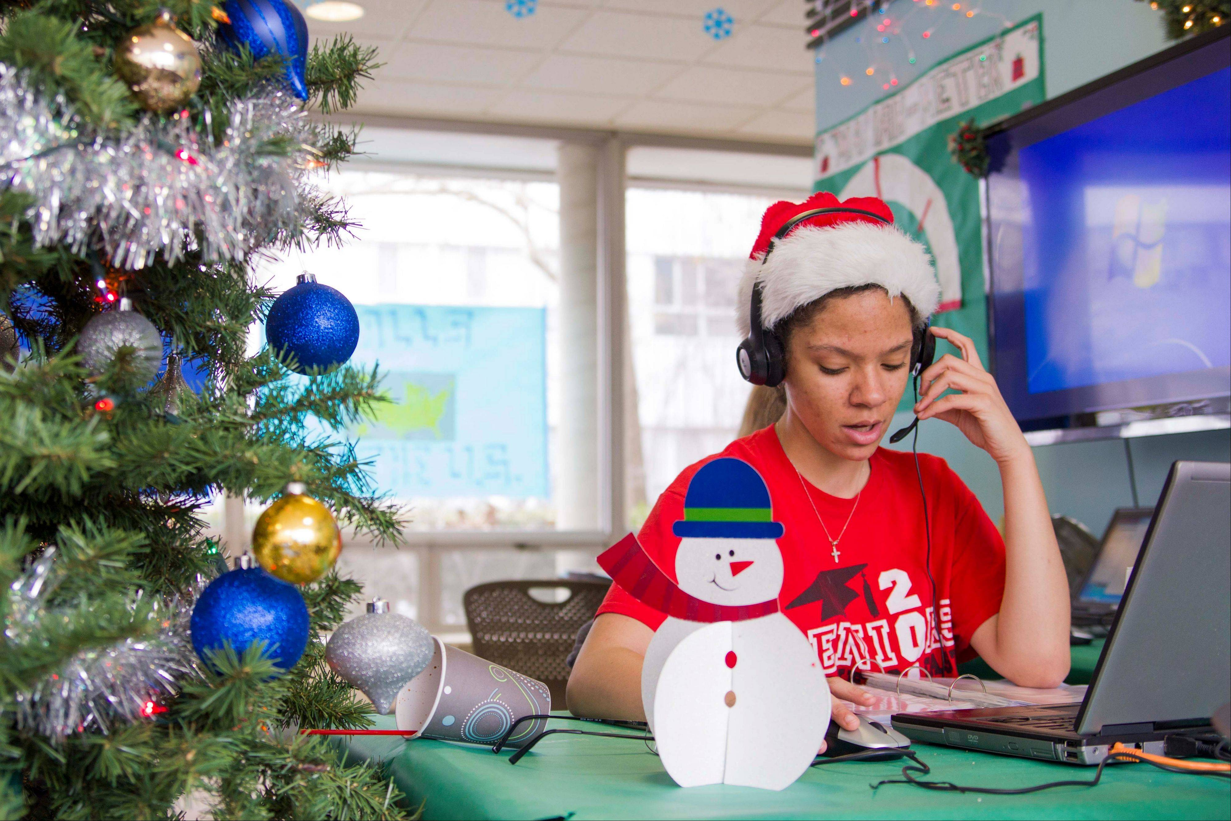Katherine Moss sings to callers as part of the hall�s annual Dial-A-Carol program in Champaign. The student-run project is a hotline of sorts for people who prefer their holiday carols sung live by amateurs.