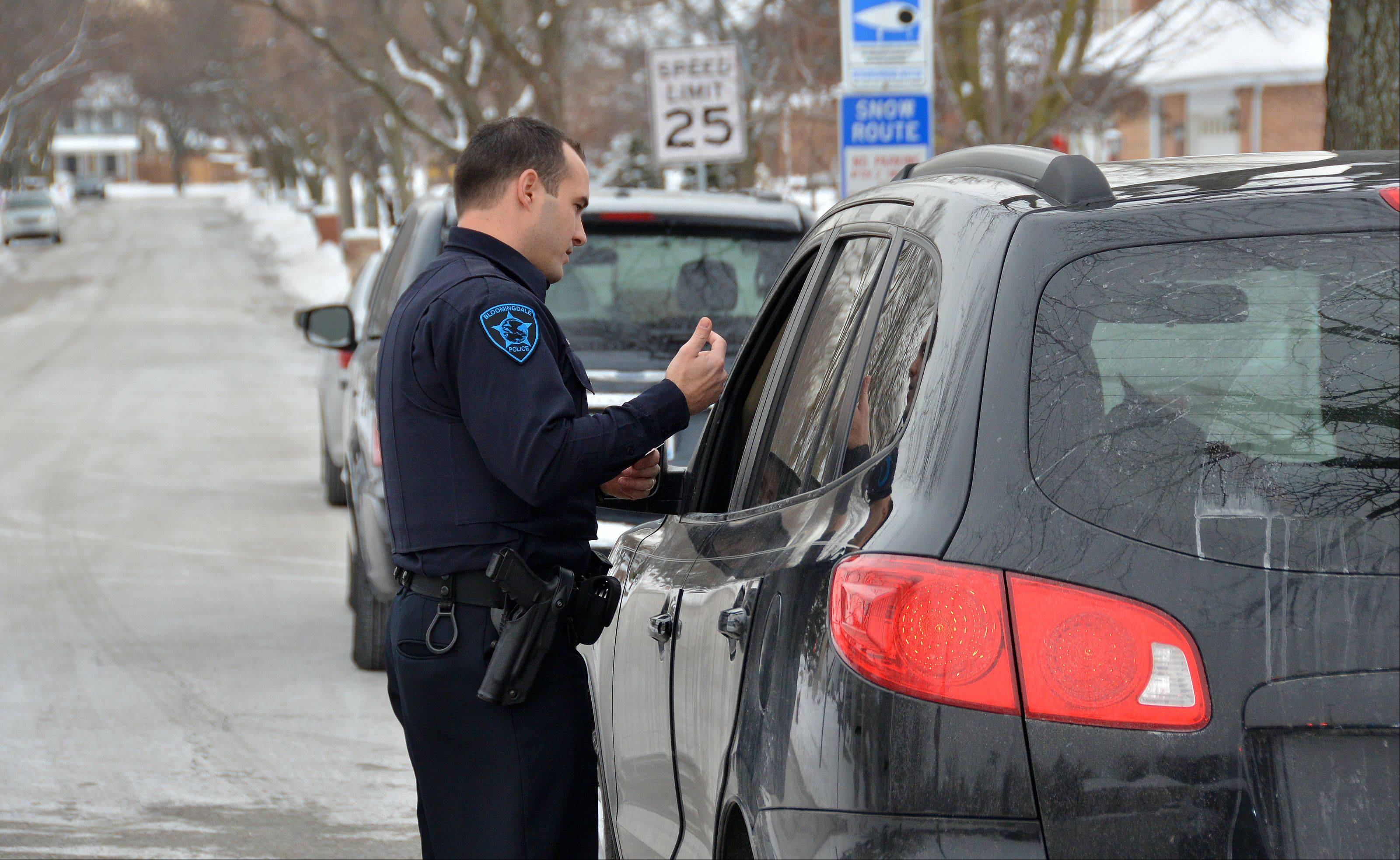 Bloomingdale Police Officer Levi McGhee warns a driver about speeding. McGhee, like many officers, believes having better access to FOID information would make police safer during such stops.