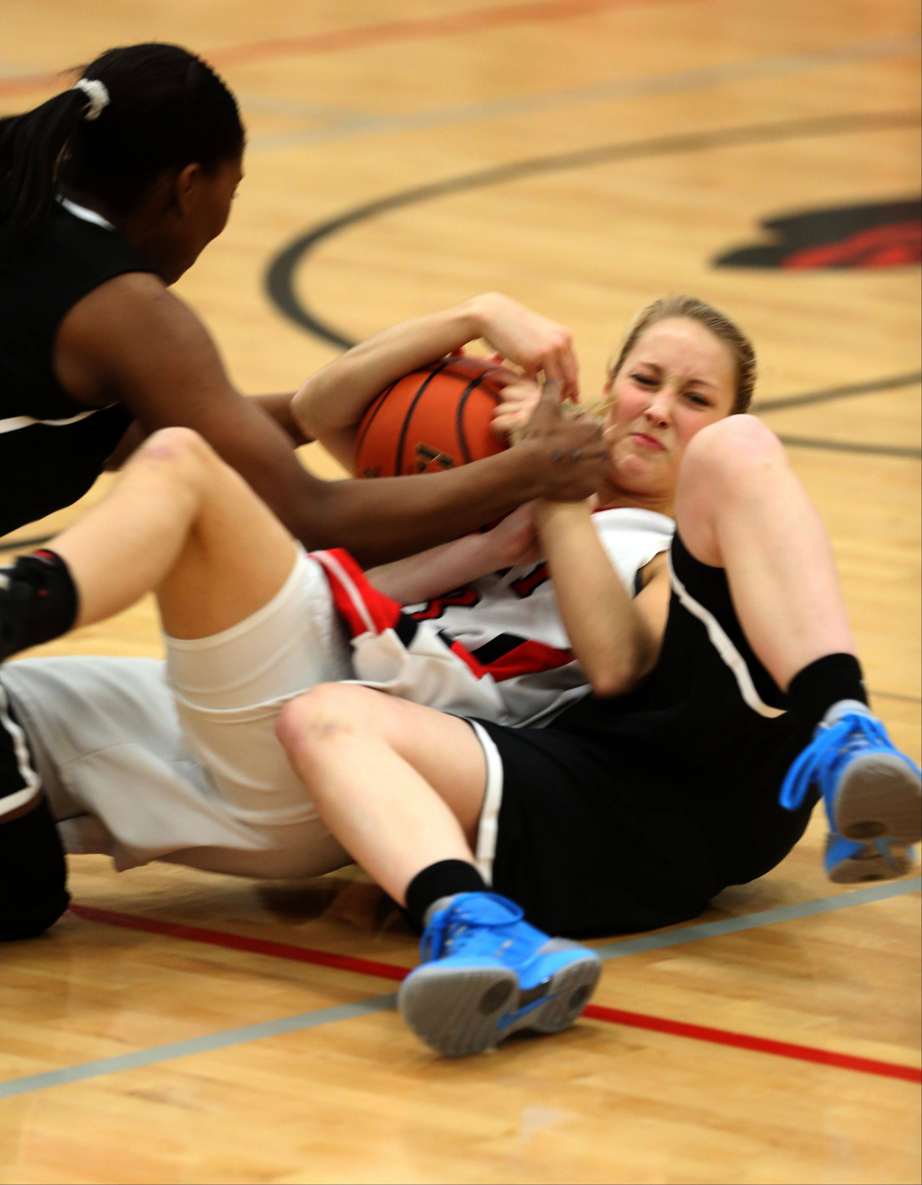 Benet's Emily Eshoo battles for a loose ball against Fenwick during girls basketball action in Lisle.