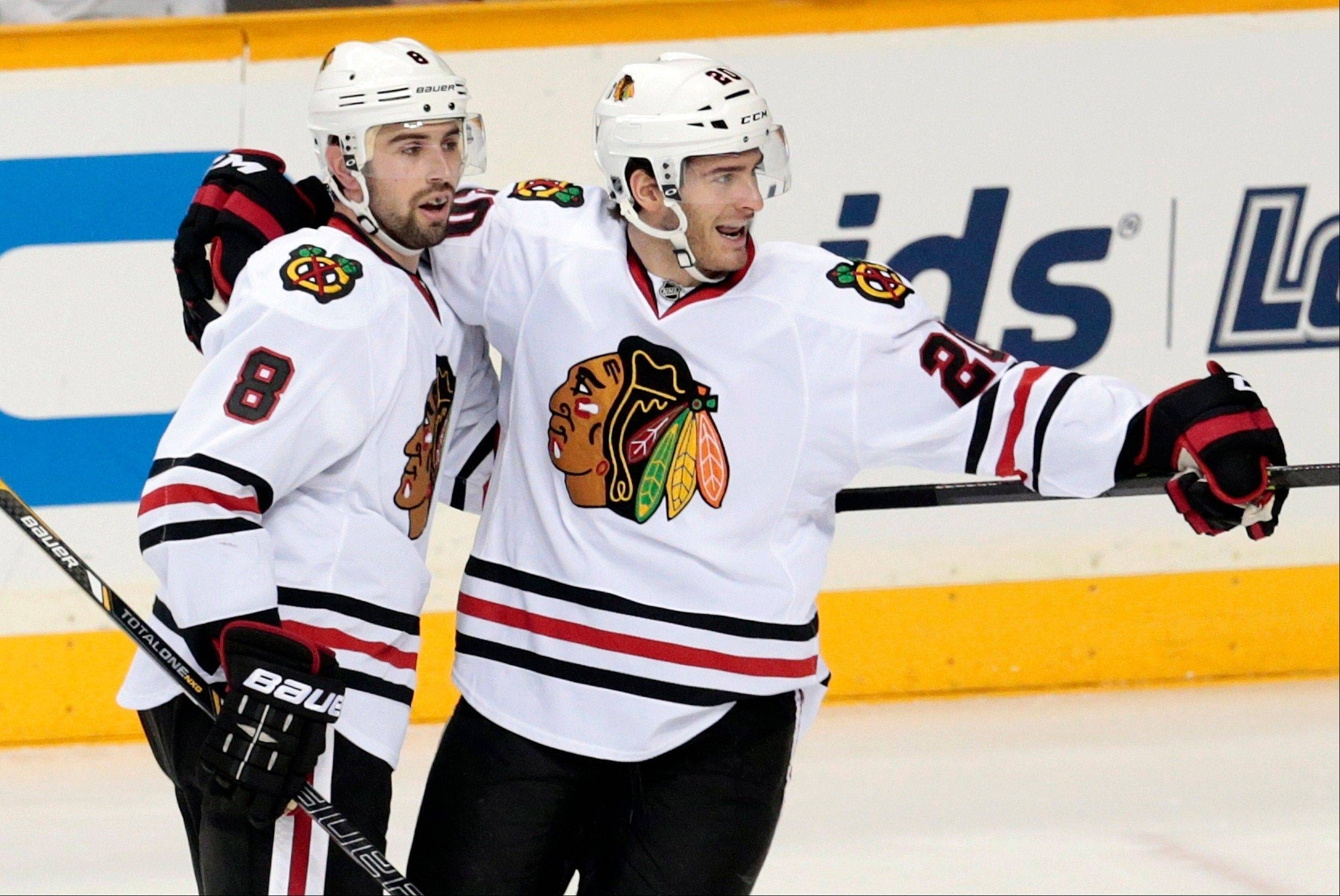 Chicago Blackhawks defenseman Nick Leddy (8) celebrates with Brandon Saad after Leddy scored against the Nashville Predators in the second period of an NHL hockey game Tuesday, Dec. 17, 2013, in Nashville, Tenn. (AP Photo/Mark Humphrey)