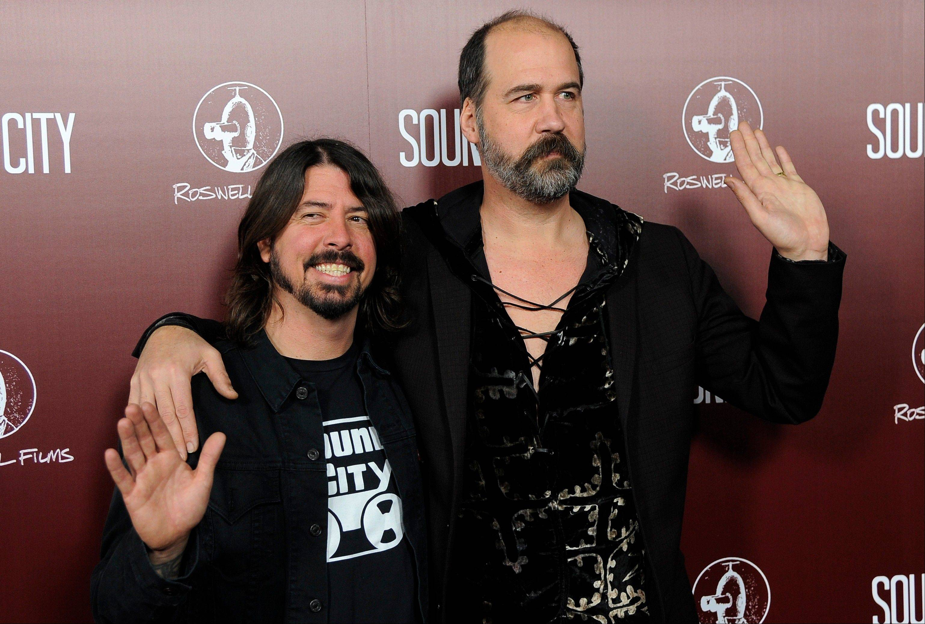 "Dave Grohl, left, poses with Nirvana bandmate Krist Novoselic at the premiere of the documentary film ""Sound City,"" in Los Angeles. Nirvana will be inducted into the 2014 Rock and Roll Hall of Fame on April 10 at the Barclays Center in New York."