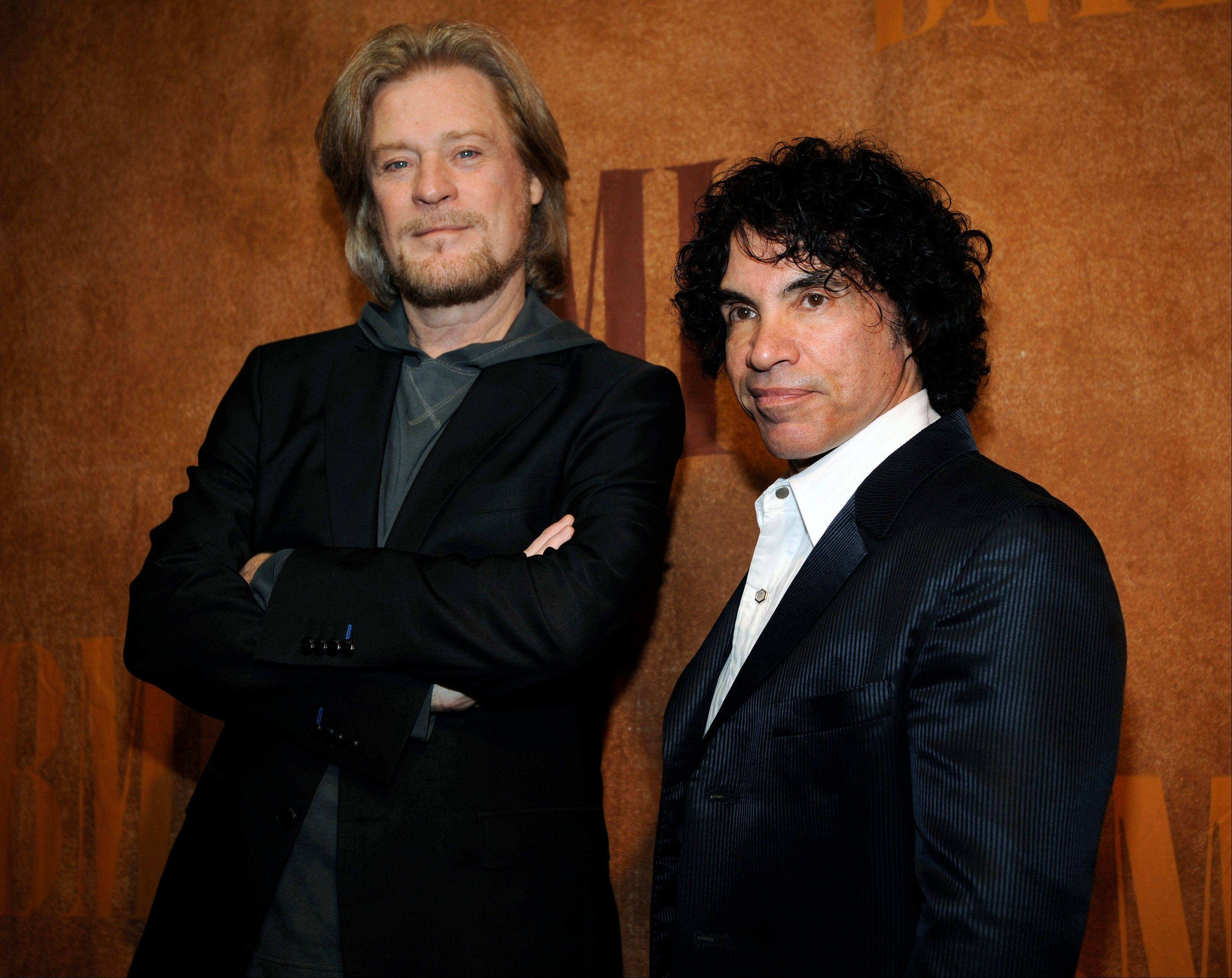Daryl Hall, left, and John Oates pose before the 56th annual BMI Pop Awards in Beverly Hills, Calif. Hall and Oates will be inducted into the 2014 Rock and Roll Hall of Fame on April 10 at the Barclays Center in New York.