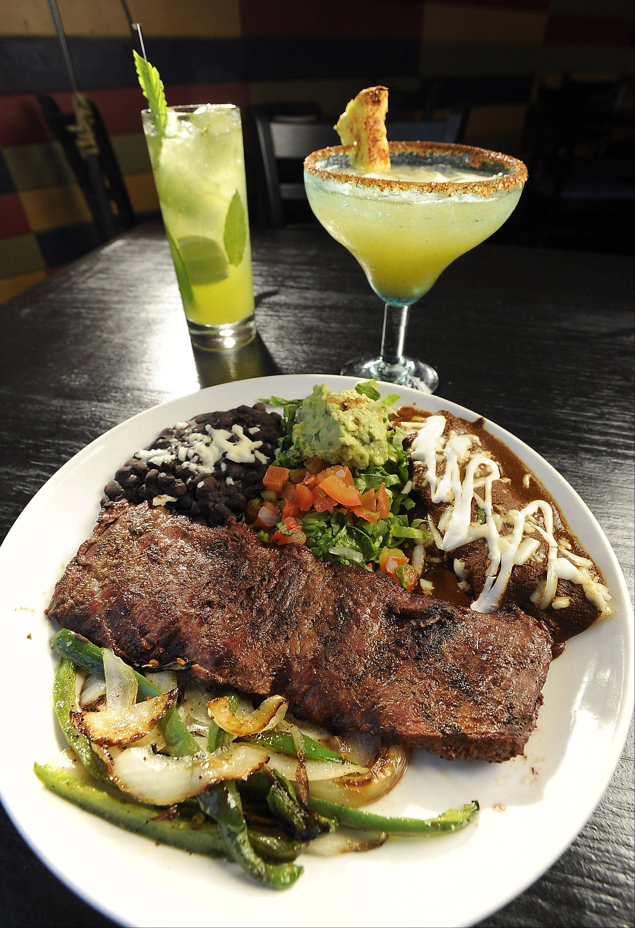 Tampiquena, cilantro-marinated outer skirt steak, is one of the featured items at Mia's Cantina restaurant in Mount Prospect. Try it with a Mia's Mojito, left, or a Pinarita.