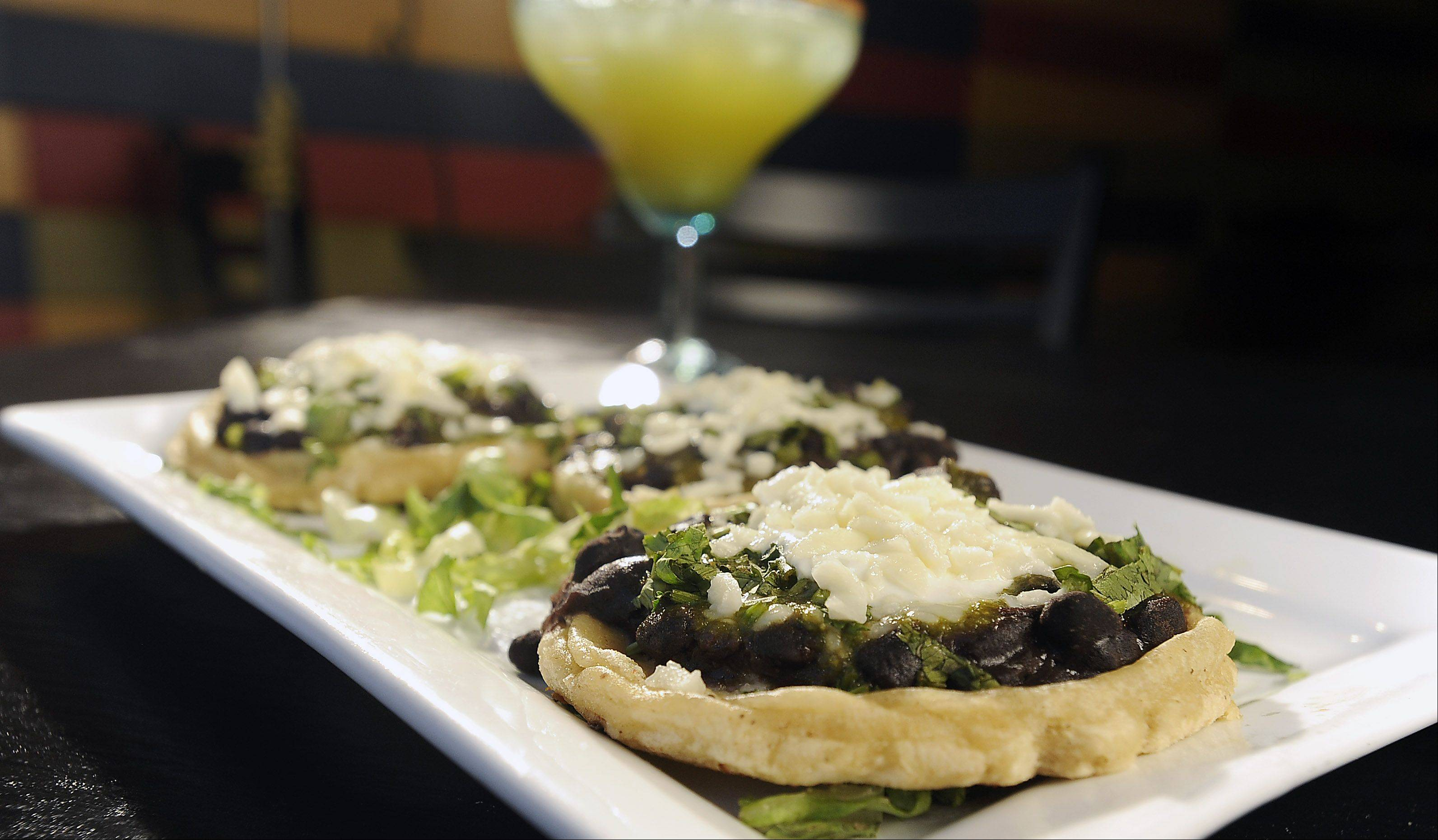 Handmade to order, Mia's Cantina's corn masa boats called sopes get topped with black beans and cilantro, onions and sour cream.