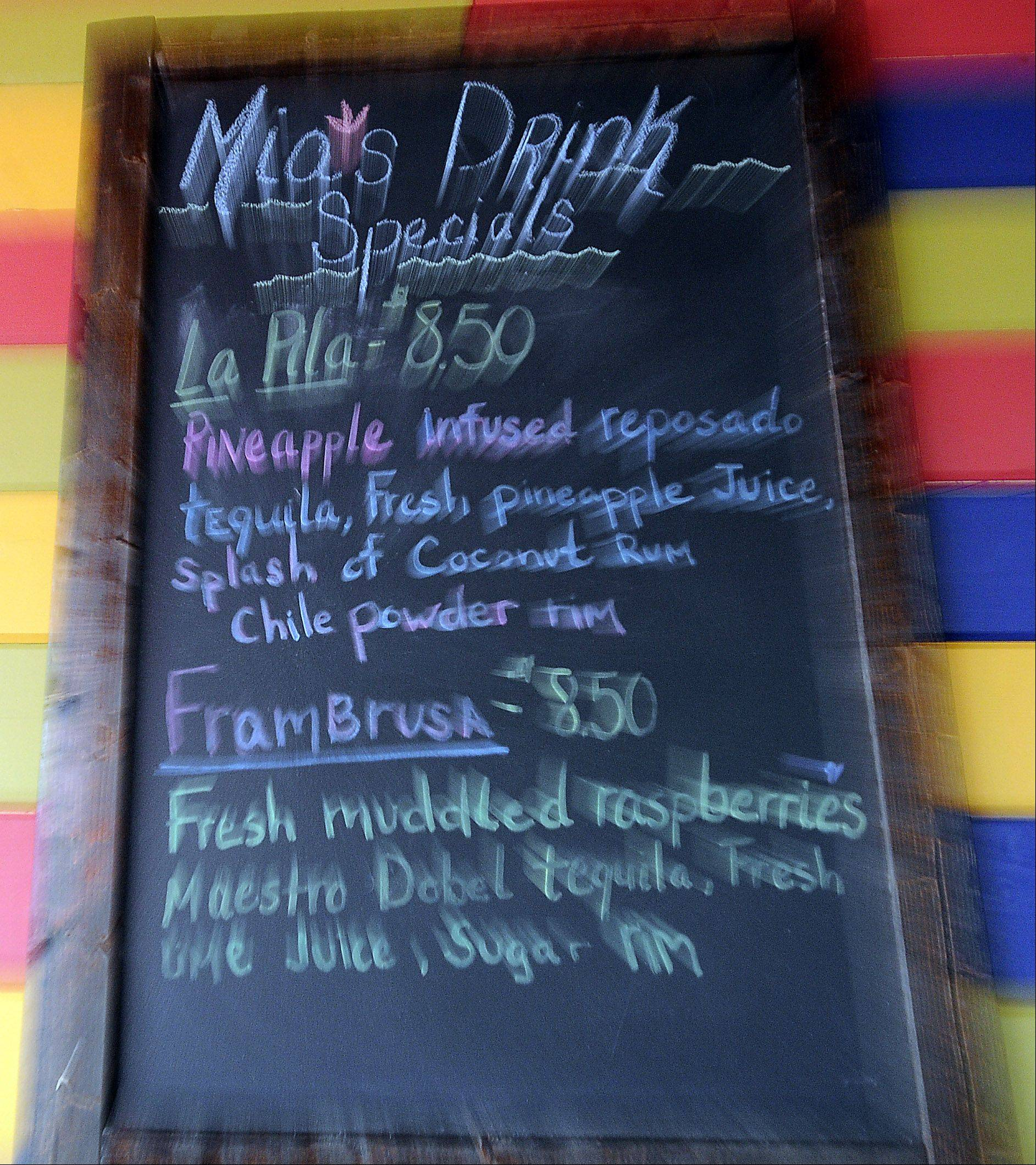 Mia's Cantina restaurant in Mount Prospect displays drink specials on a handwritten board.