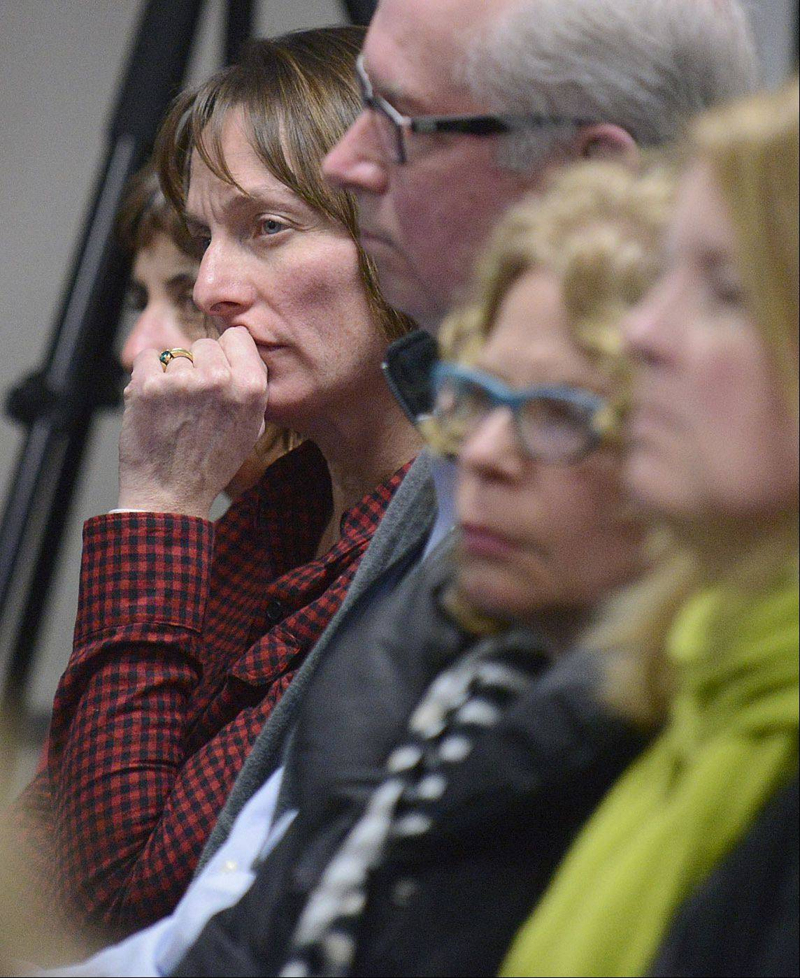 Lisa Foydel, a nine-year resident of Batavia, listens to fellow residents during the public comment section of the Batavia school board on Tuesday night. Foydel is in support of the levy.