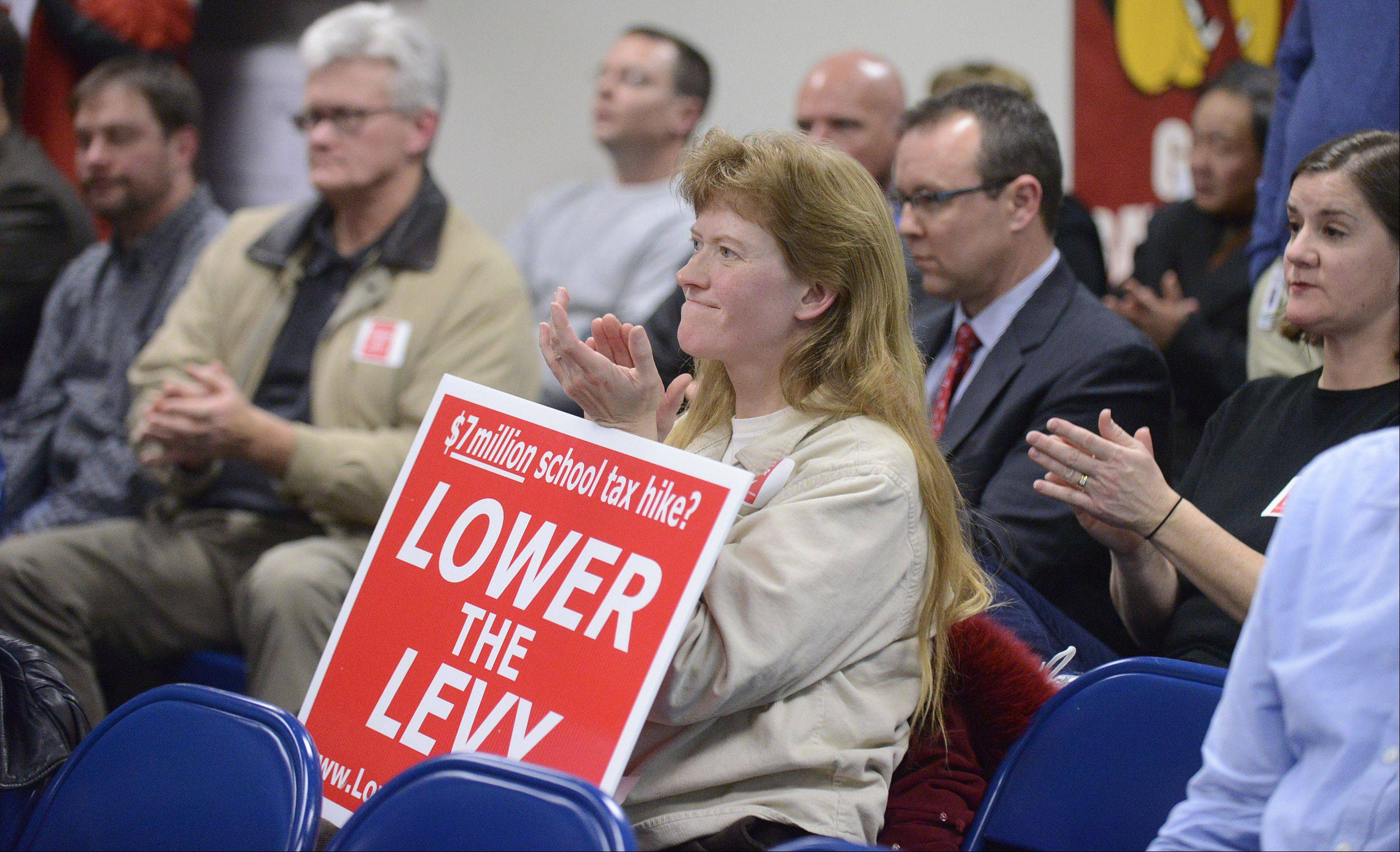 Batavia resident of 15 years, Sylvia Keppel, applauds a fellow resident who opposes the levy increase during the public comment section at the Batavia school board meeting on Tuesday night. The majority of the crowd asked the school board to not go for as much property taxes as it could. The protestors say that, with the addition of the Aurora Outlet Mall's tax payments finally going to the school district after being in a TIF district, the rest of the taxpayers should get a break.