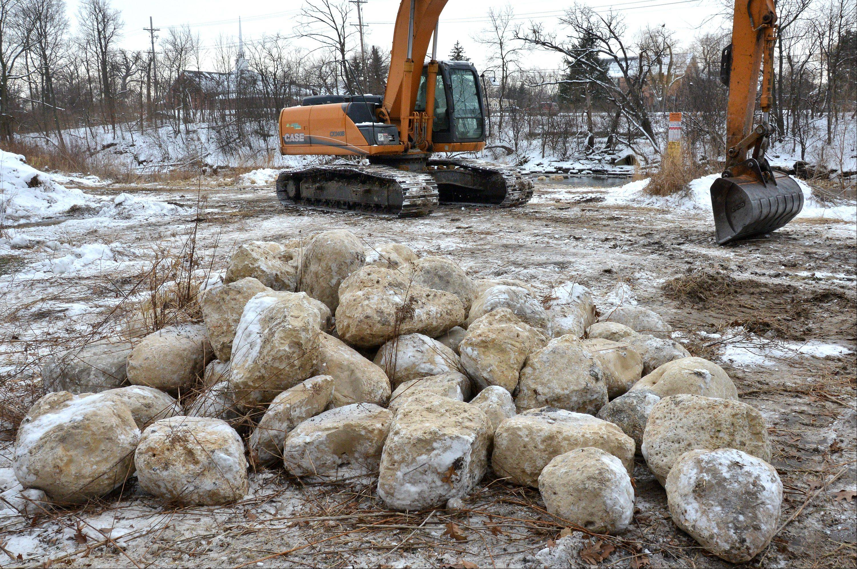 Rocks are being used to create riffles along the West Branch of the DuPage River at McDowell Grove Forest Preserve near Naperville.
