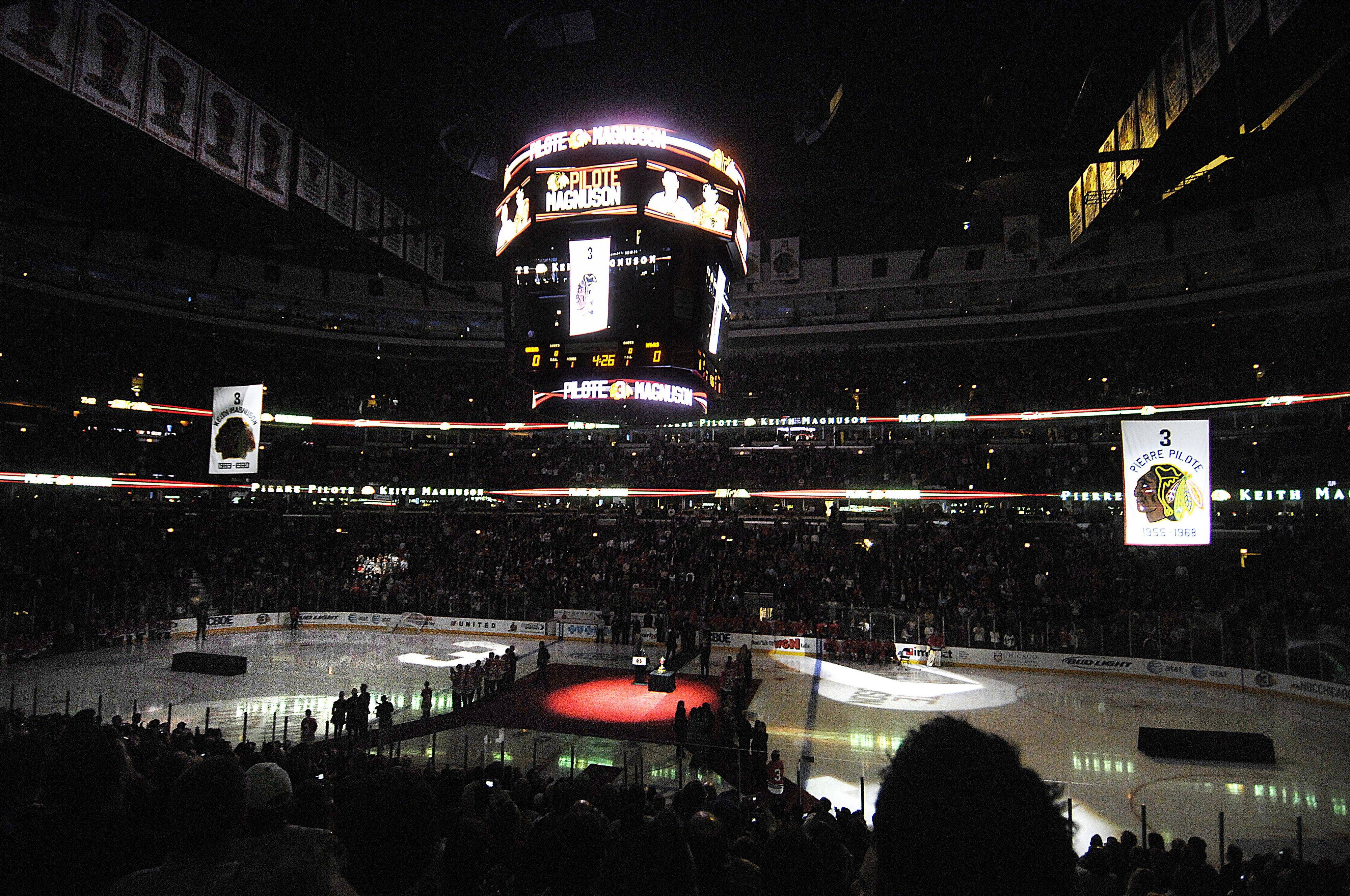 Banners honoring Pierre Pilote and the late Keith Magnuson are raised to the rafters at the United Center.