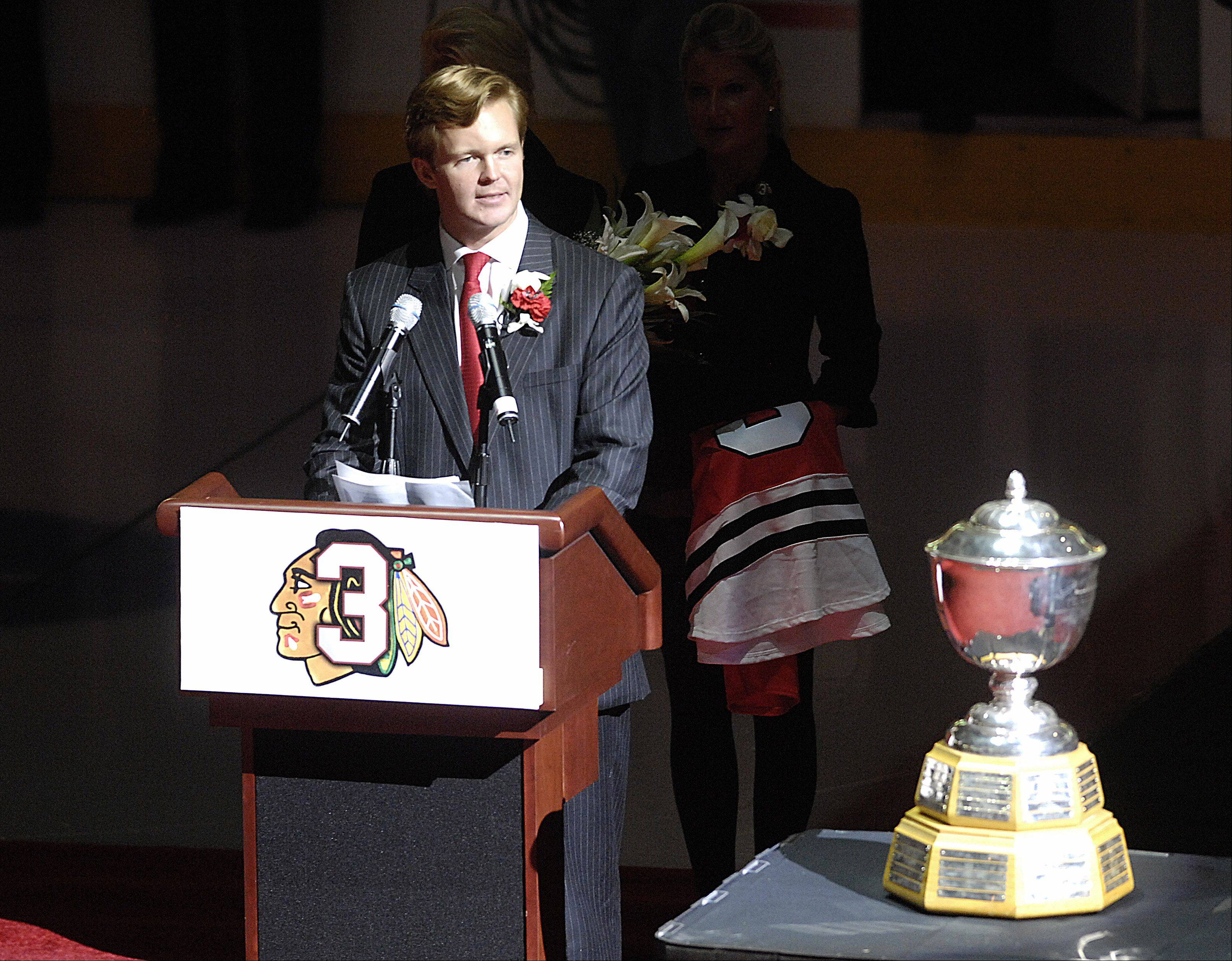 Kevin Magnuson, son of the late Keith Magnuson, speaks during a number retirement ceremony for the former Chicago Blackhawk.