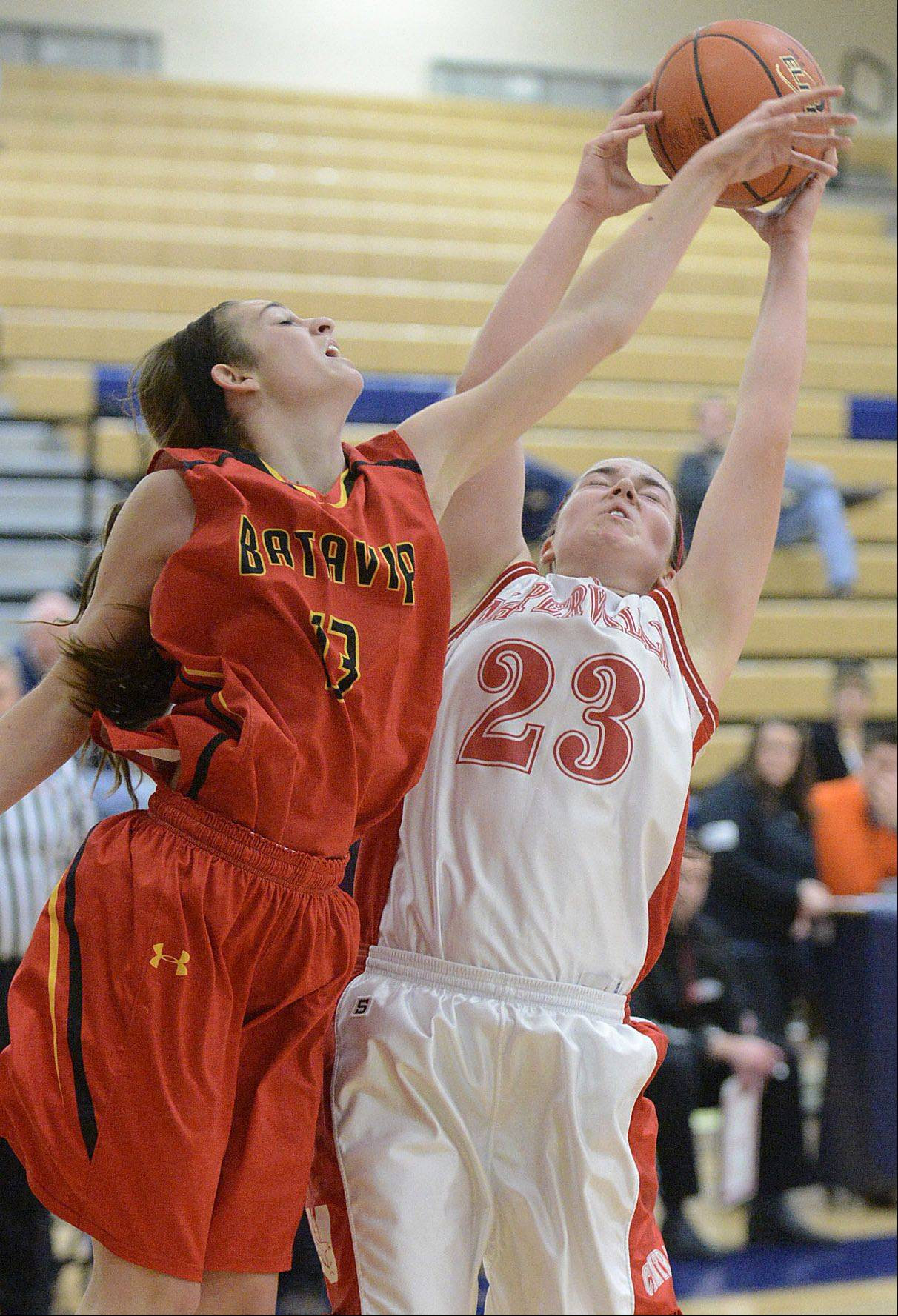 Batavia's Mackenzie Foster and Naperville Central's Lisa Tassi fight for a rebound Saturday.