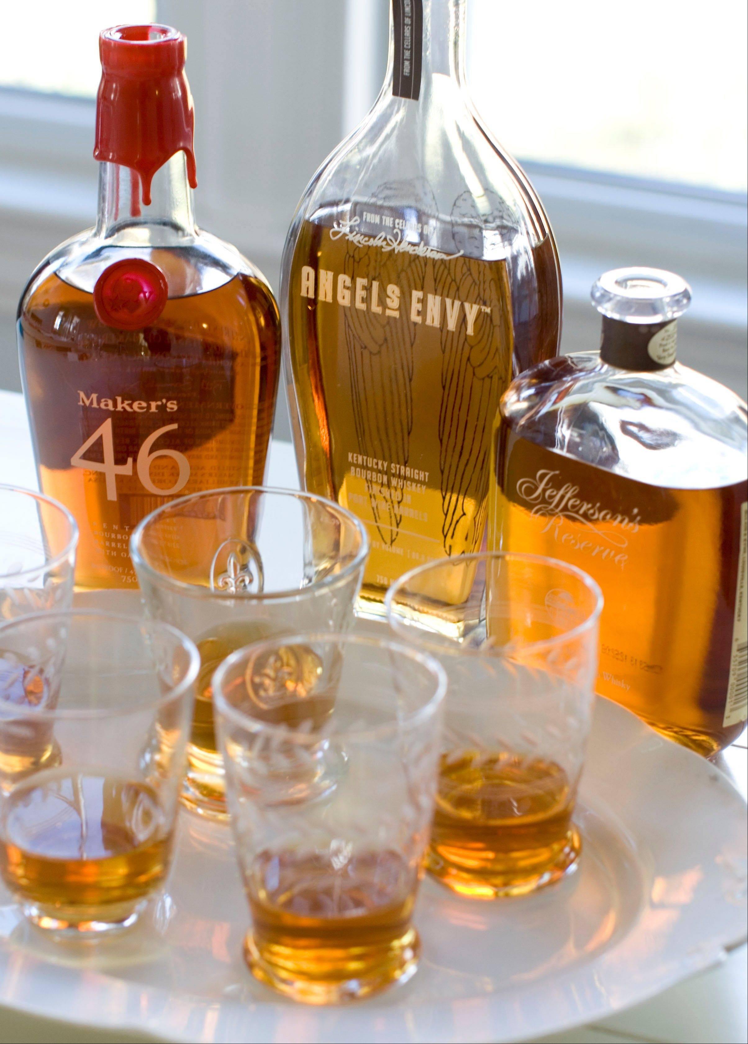 Picking a bourbon isn't the one-two-three choice it used to be. There's been a boom in brands and styles like Maker's 46, from left, Angels Envy and Jefferson's Reserve.